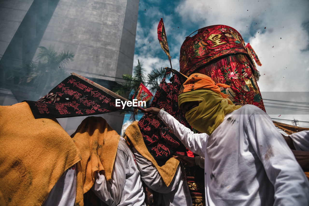 Low Angle View Of Man Wearing Traditional Clothing During Celebration