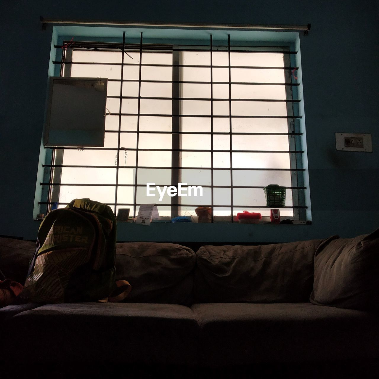 window, furniture, indoors, domestic room, sofa, home interior, no people, glass - material, day, pillow, architecture, relaxation, sunlight, living room, built structure, building, bed, absence, house