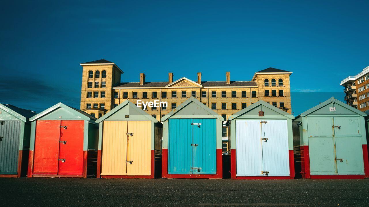 Houses At Beach Against Clear Blue Sky