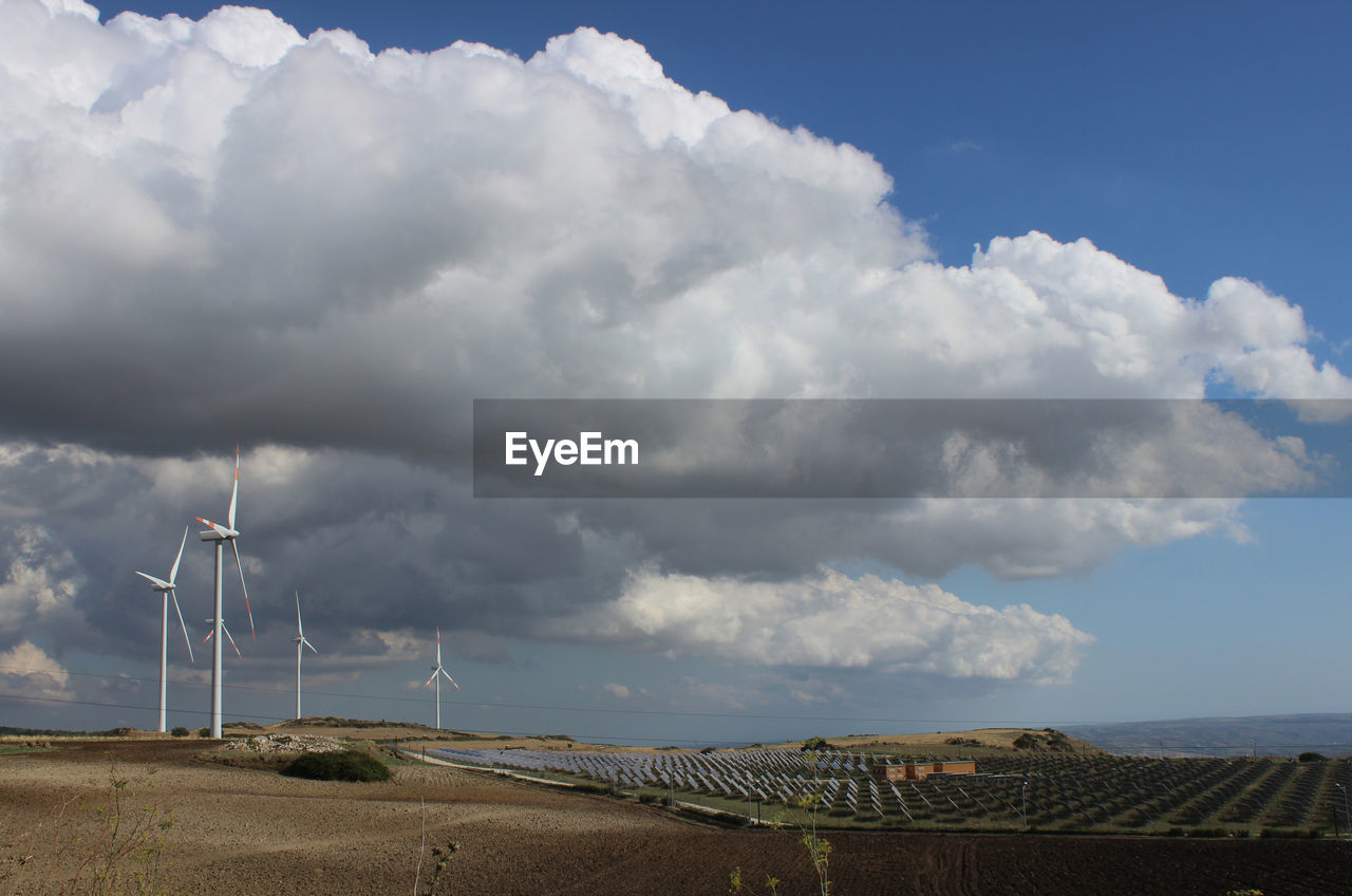 cloud - sky, sky, wind turbine, environmental conservation, alternative energy, environment, fuel and power generation, turbine, wind power, renewable energy, nature, beauty in nature, day, scenics - nature, land, technology, landscape, no people, built structure, architecture, outdoors, sustainable resources