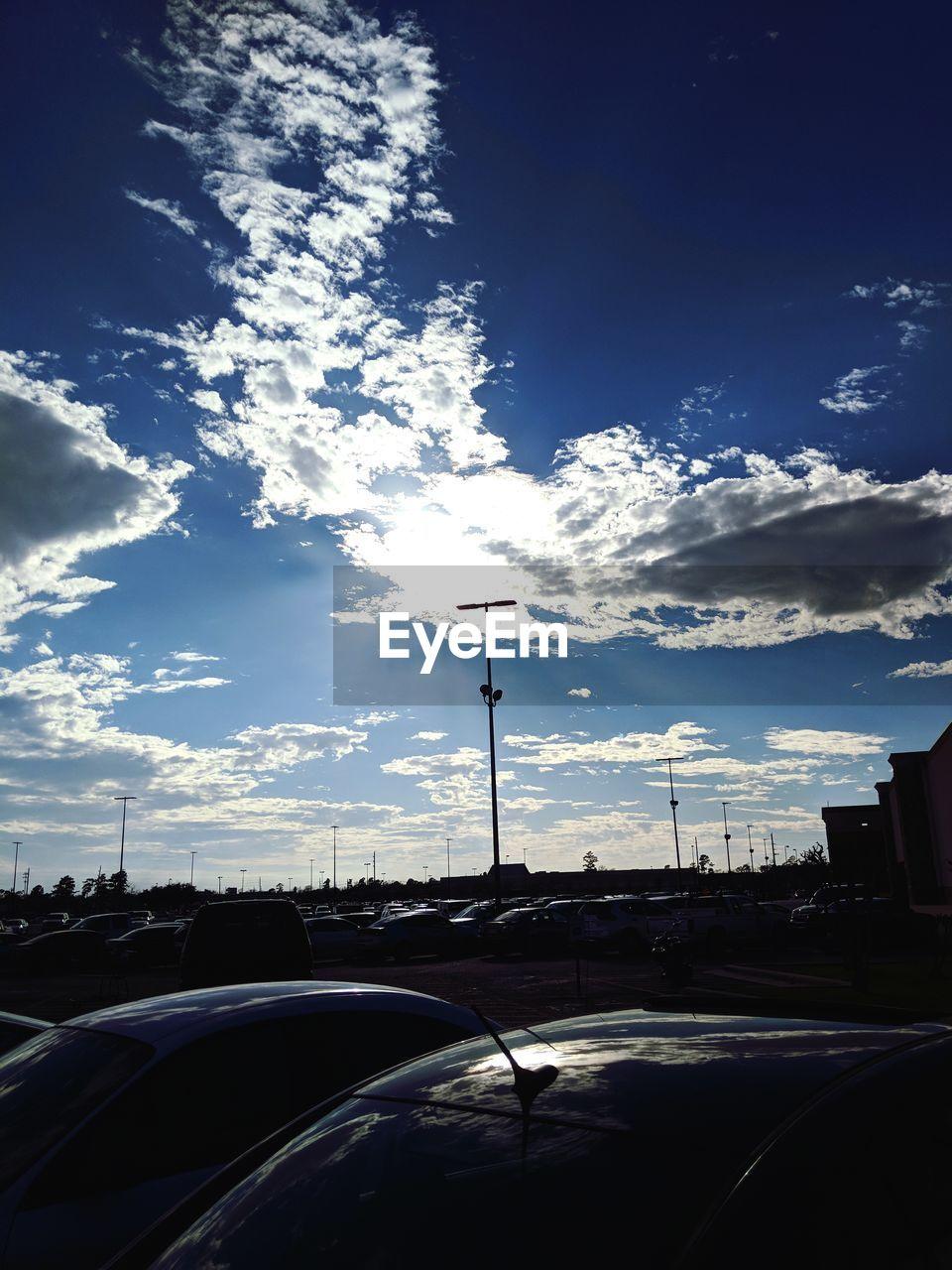 car, transportation, land vehicle, mode of transport, sky, car interior, street light, cloud - sky, no people, day, road, outdoors, tree, nature