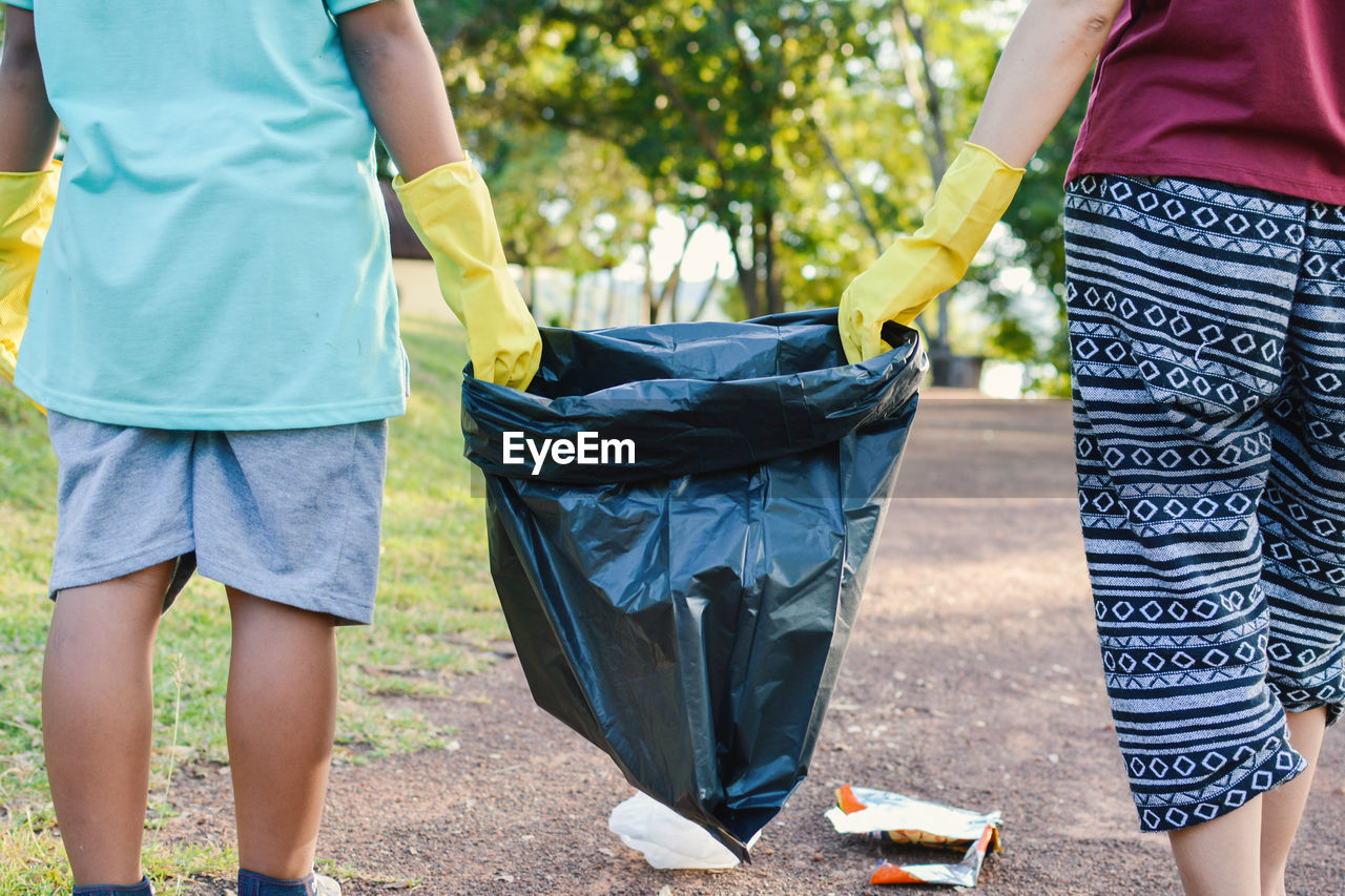 Low Section Of People Collecting Garbage
