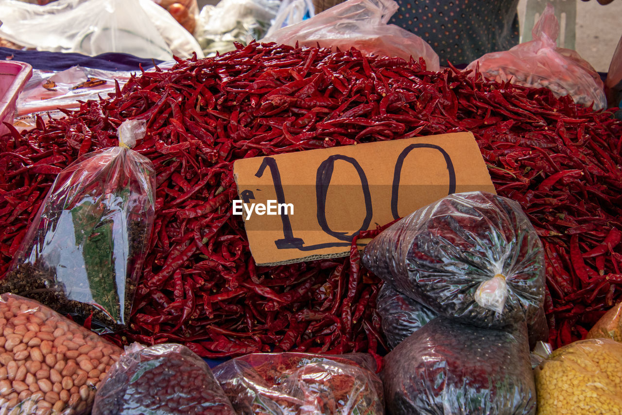 market, retail, market stall, for sale, food and drink, food, choice, variation, business, freshness, price tag, communication, abundance, large group of objects, dried food, chili pepper, small business, retail display, text, spice, plastic bag, no people, red chili pepper, sale