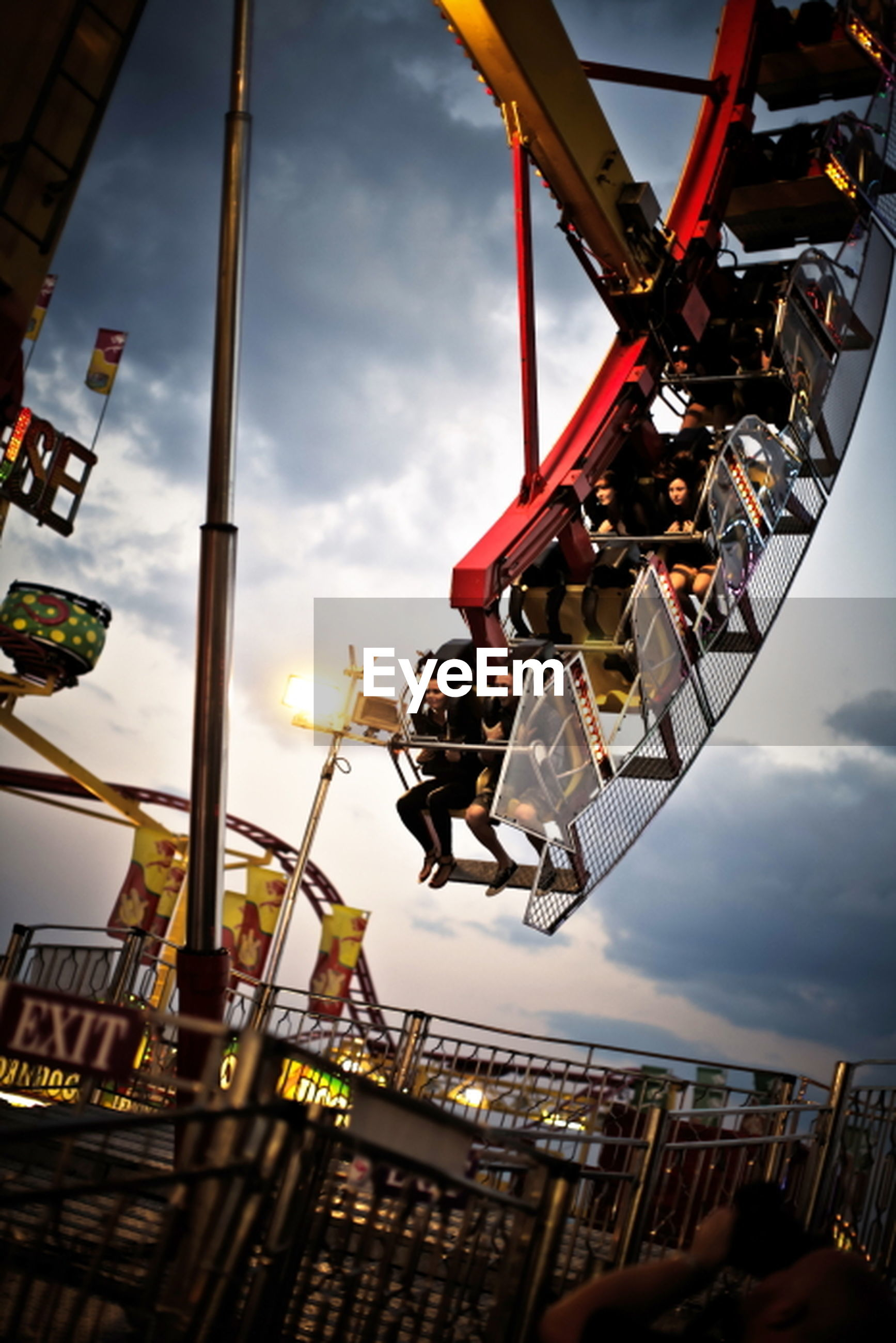 sky, low angle view, built structure, architecture, cloud - sky, building exterior, city, cloudy, metal, day, cloud, outdoors, hanging, transportation, large group of objects, incidental people, construction site, no people, sunlight, amusement park