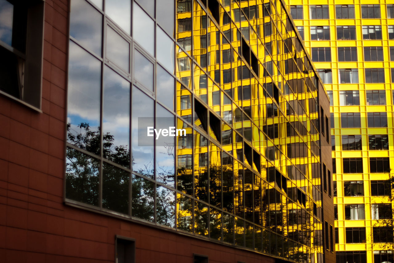 LOW ANGLE VIEW OF YELLOW OFFICE BUILDING