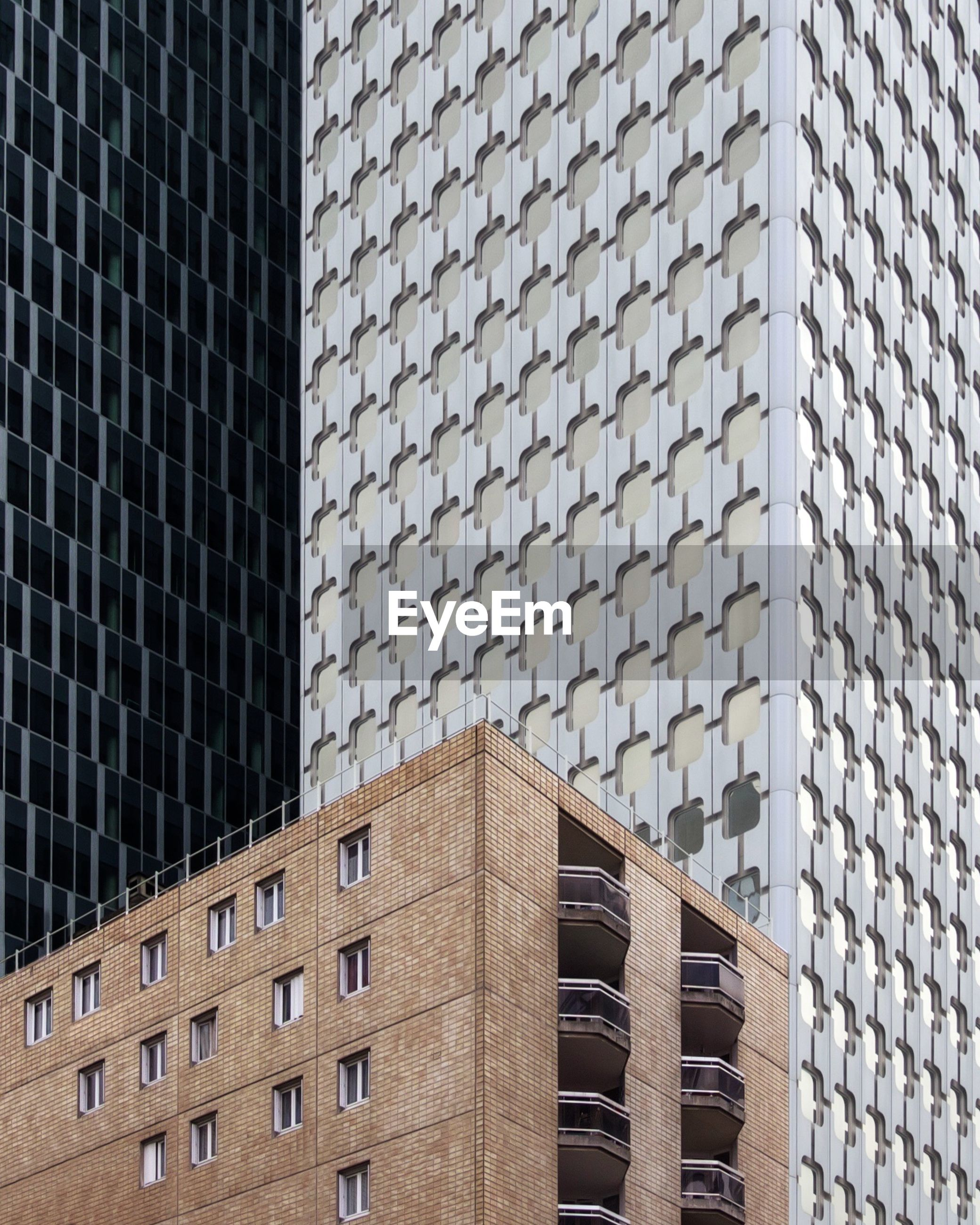 built structure, architecture, building exterior, building, low angle view, no people, city, modern, window, office building exterior, day, pattern, office, outdoors, tall - high, repetition, nature, sunlight, sky, skyscraper