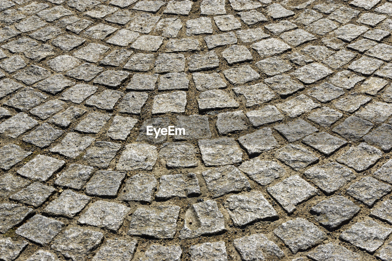 full frame, backgrounds, pattern, textured, cobblestone, no people, footpath, street, paving stone, stone, stone material, nature, solid, high angle view, day, outdoors, city, rough, gray, repetition, textured effect, concrete