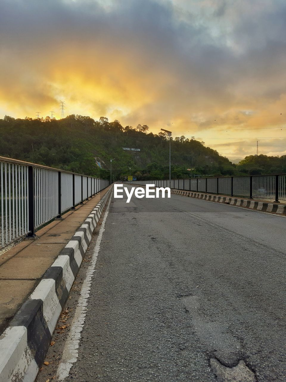 sky, sunset, cloud - sky, road, direction, transportation, the way forward, nature, railing, tree, no people, beauty in nature, built structure, plant, city, architecture, connection, tranquility, street, footpath, diminishing perspective, outdoors