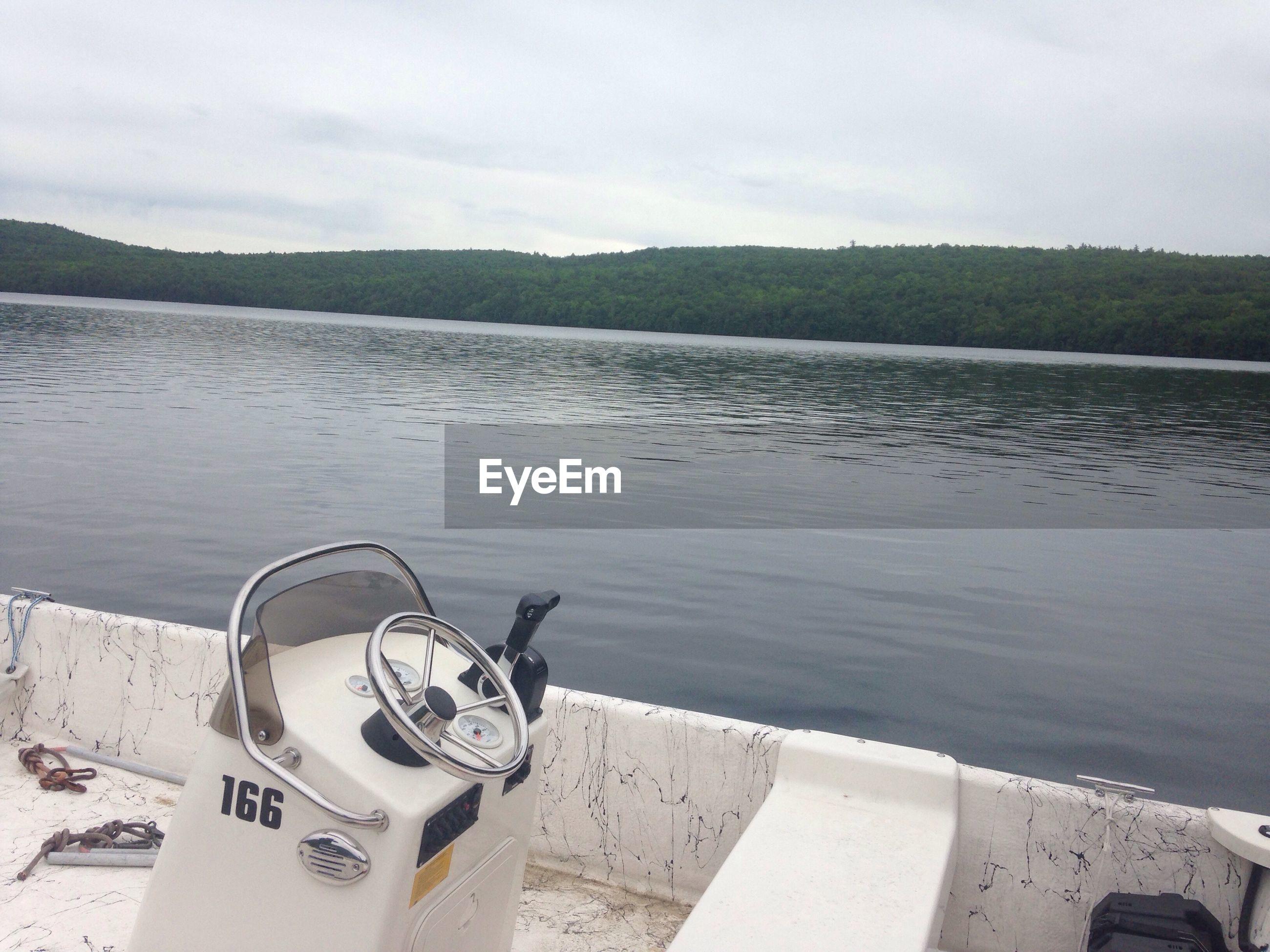 Motorboat moored on lake
