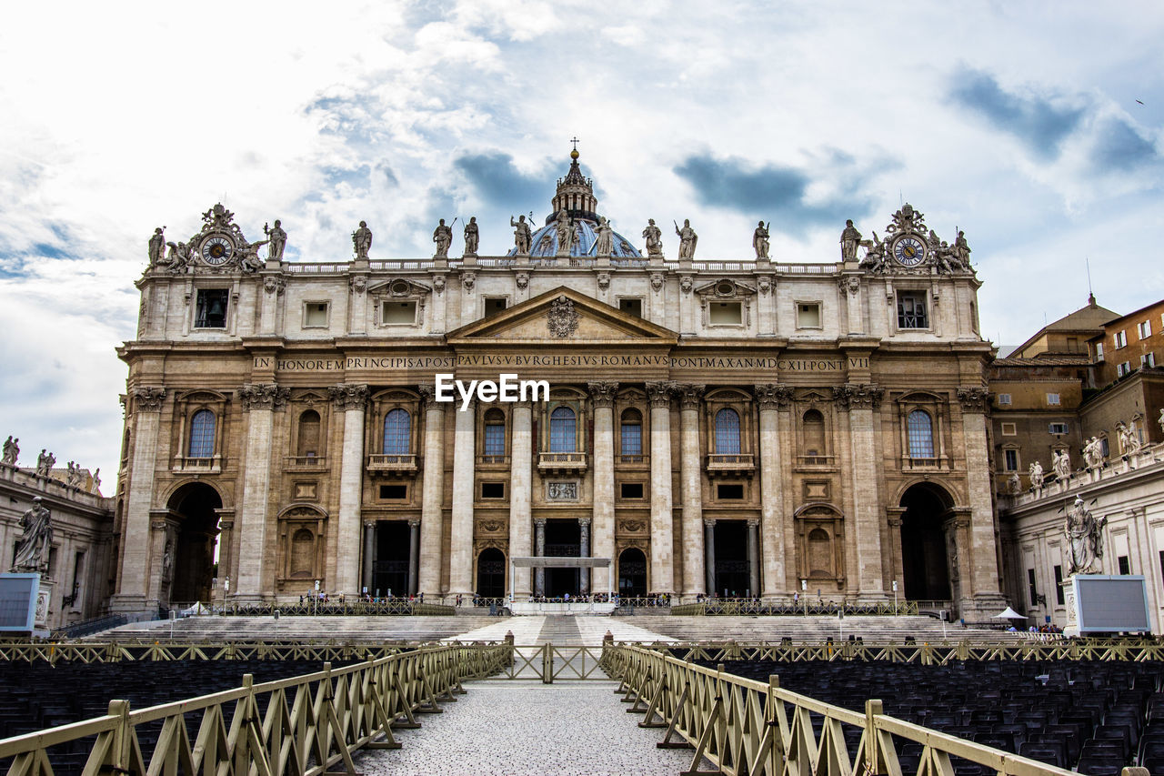 Empty Chairs By St Peters Basilica Against Sky