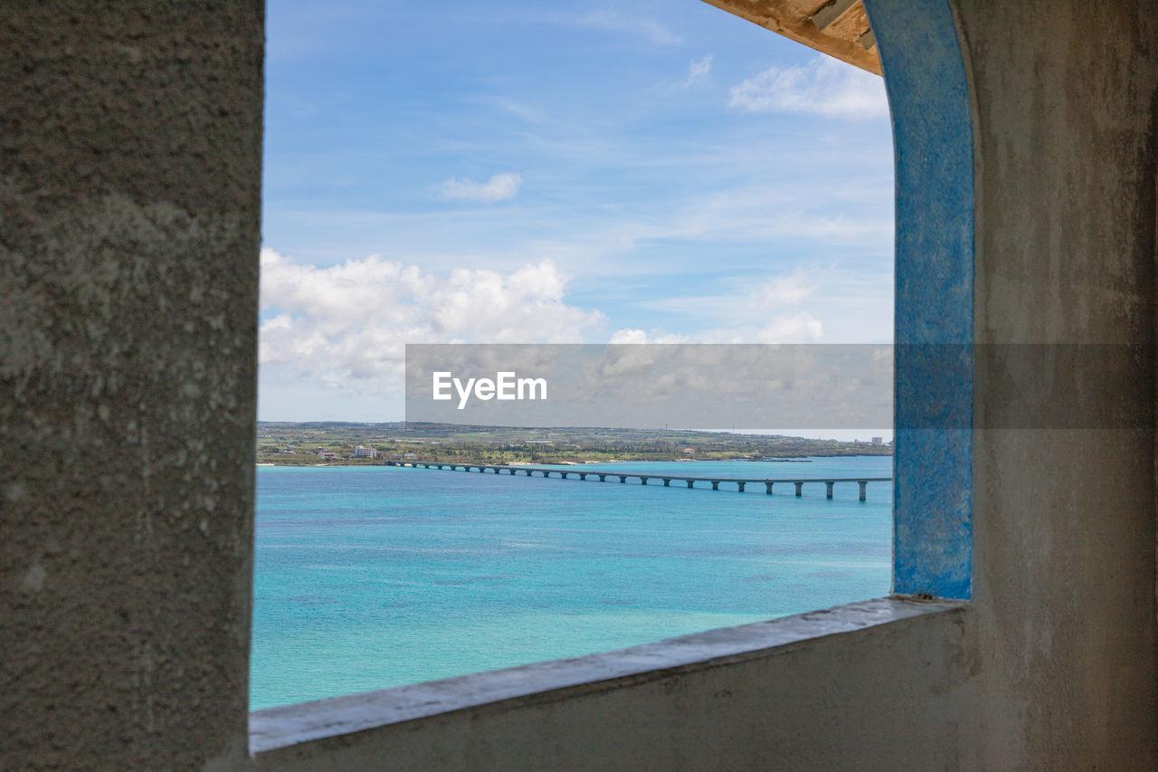 Sea Seen Through Window
