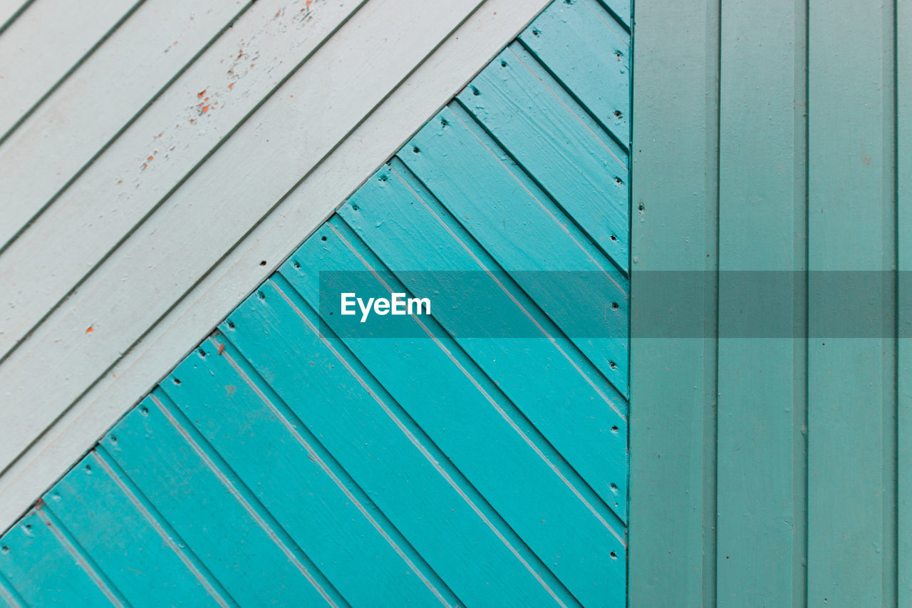 wood - material, pattern, full frame, green color, no people, backgrounds, day, metal, textured, close-up, architecture, outdoors, built structure, plank, blue, old, turquoise colored, entrance, weathered, striped, iron, corrugated