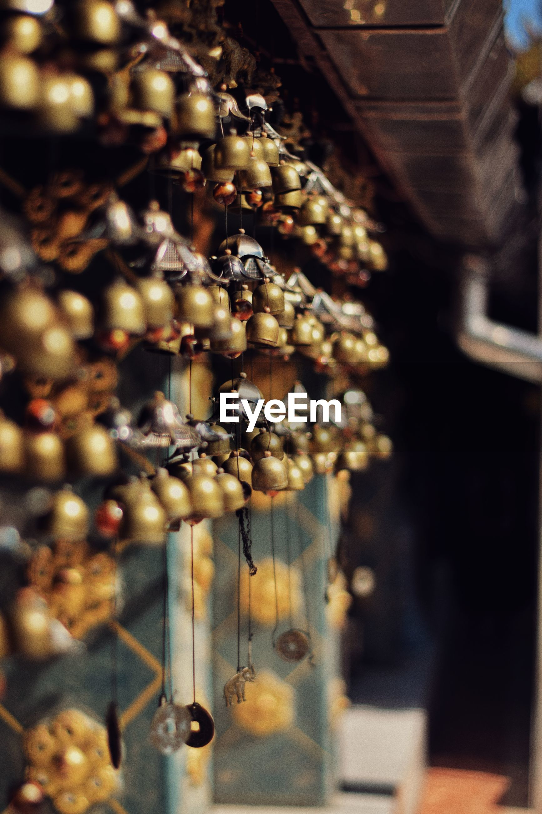 for sale, selective focus, hanging, retail, indoors, no people, close-up, large group of objects, retail display, jewelry, variation, art and craft, choice, store, abundance, market, metal, collection, shopping, focus on foreground, sale, luxury, consumerism