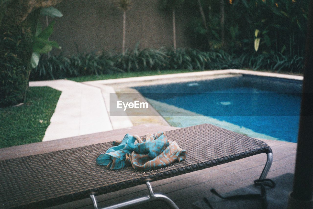 pool, swimming pool, water, no people, poolside, nature, day, chair, plant, absence, outdoors, seat, grass, table, tree, relaxation, focus on foreground, front or back yard, high angle view, luxury