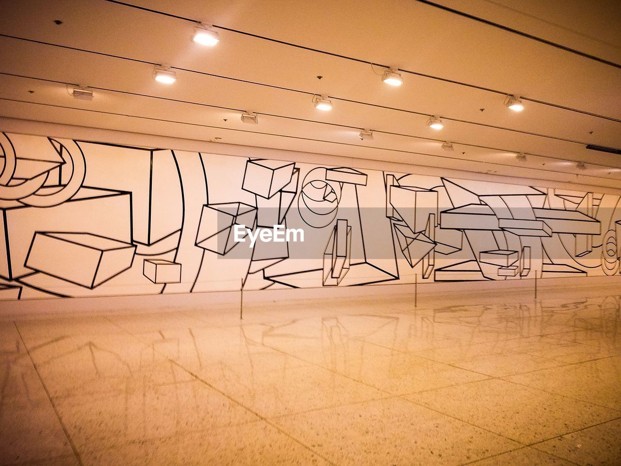 indoors, no people, architecture, art and craft, illuminated, flooring, wall - building feature, creativity, lighting equipment, built structure, drawing - art product, sketch, reflection, building, ceiling, empty, orange color, electricity, graffiti