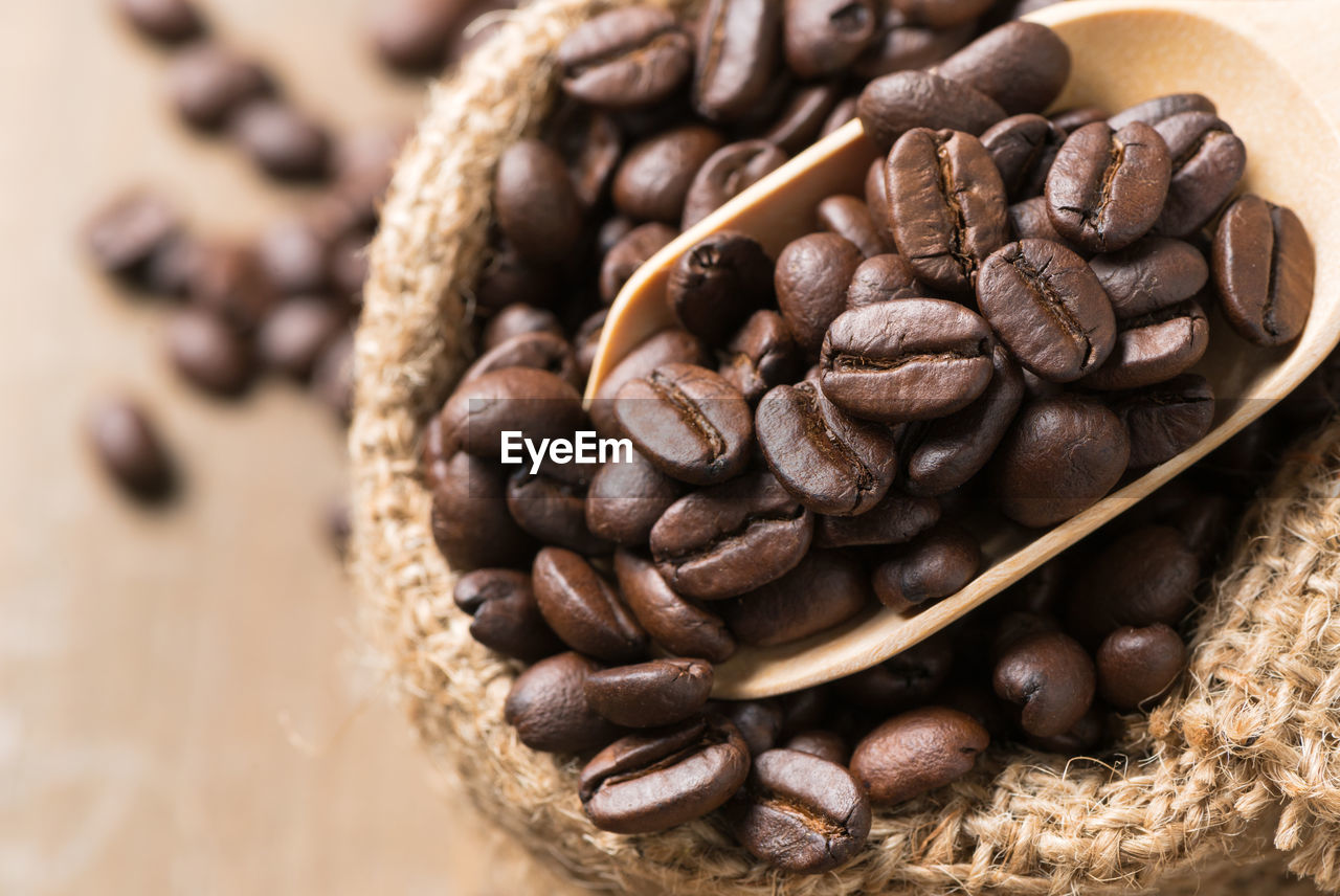food and drink, food, roasted coffee bean, coffee, coffee - drink, freshness, close-up, brown, indoors, still life, no people, large group of objects, table, high angle view, selective focus, focus on foreground, healthy eating, roasted, abundance, wellbeing, caffeine, temptation, snack