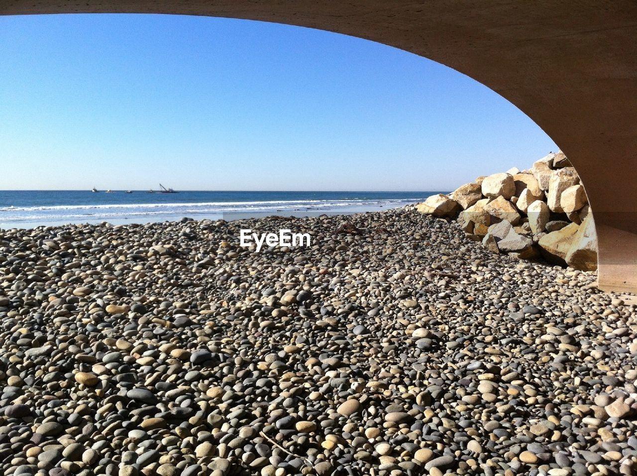 Under view of bridge at beach