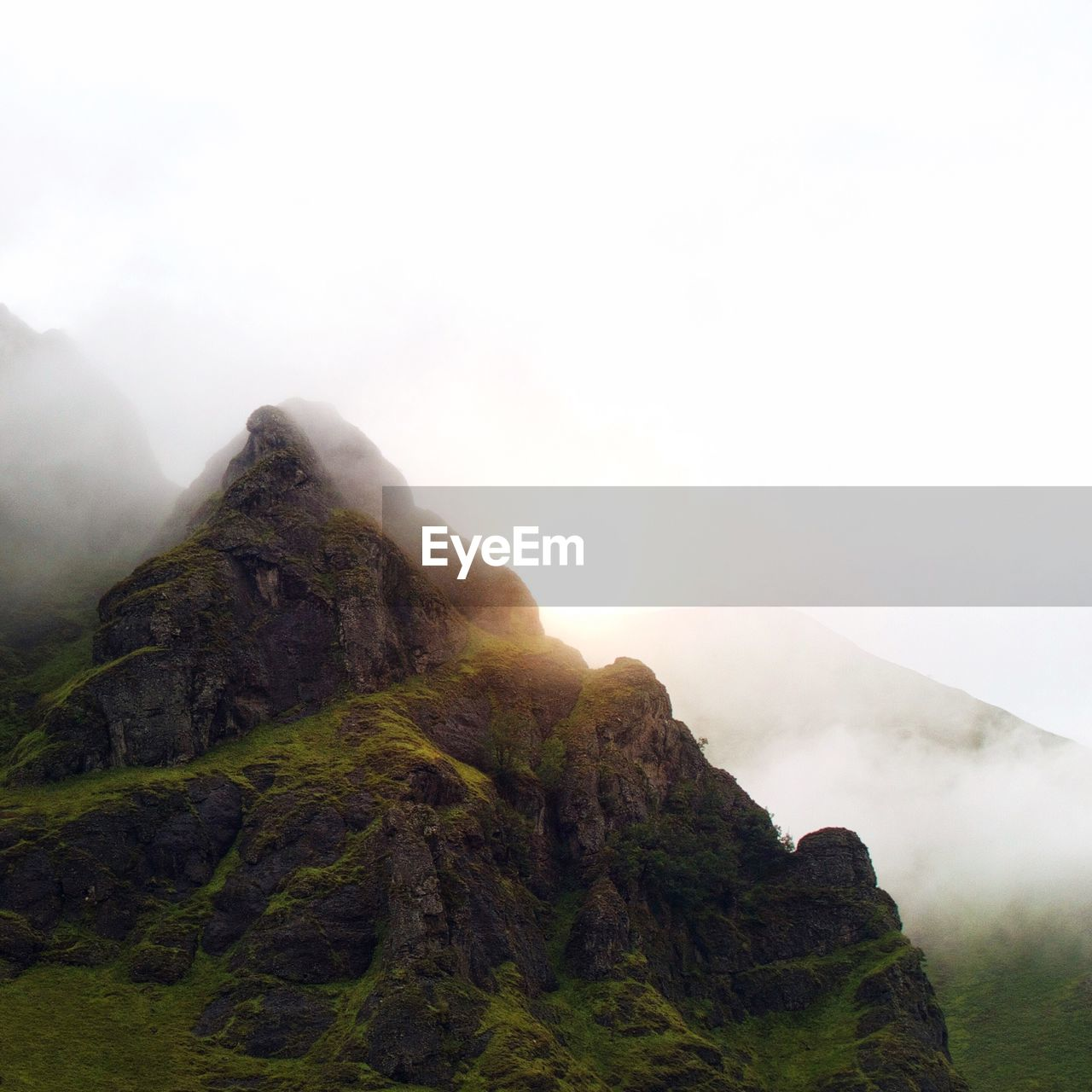 View of mountains against sky during foggy weather