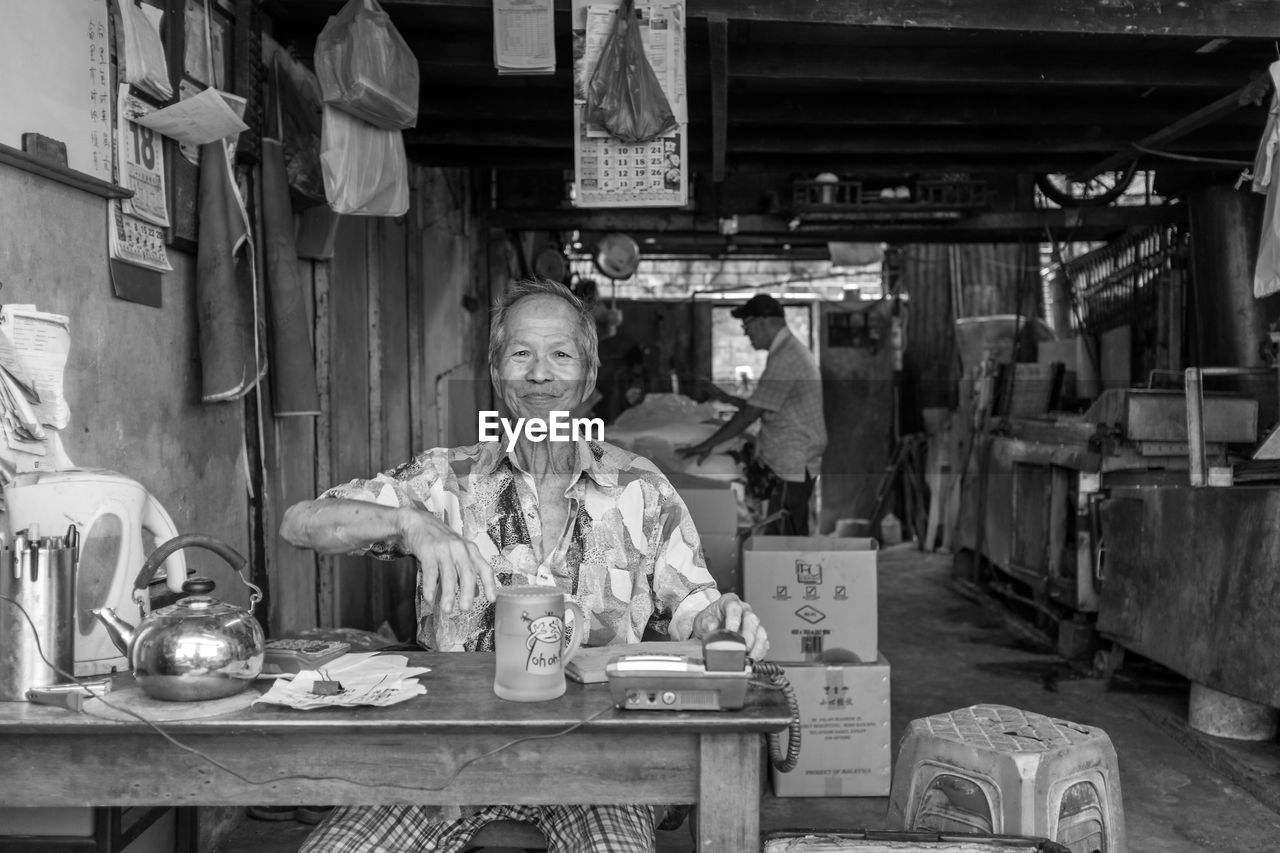 front view, one person, table, looking at camera, indoors, portrait, old-fashioned, smiling, only women, one woman only, women, adult, adults only, day, people