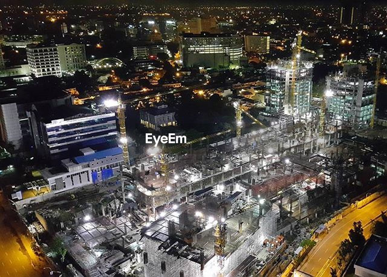 illuminated, night, cityscape, city, architecture, building exterior, aerial view, high angle view, skyscraper, built structure, city life, modern, outdoors, no people, urban skyline
