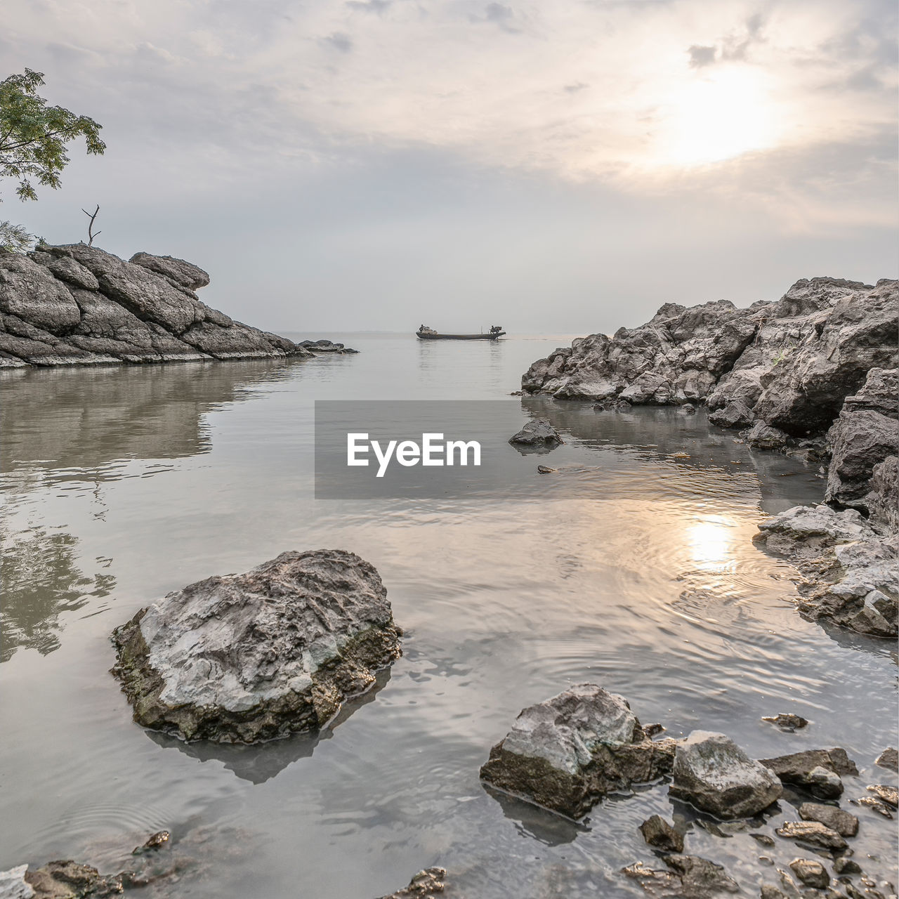 water, sky, rock, solid, rock - object, beauty in nature, scenics - nature, tranquility, sea, tranquil scene, nature, reflection, cloud - sky, no people, idyllic, beach, non-urban scene, rock formation, sunset, outdoors, shallow