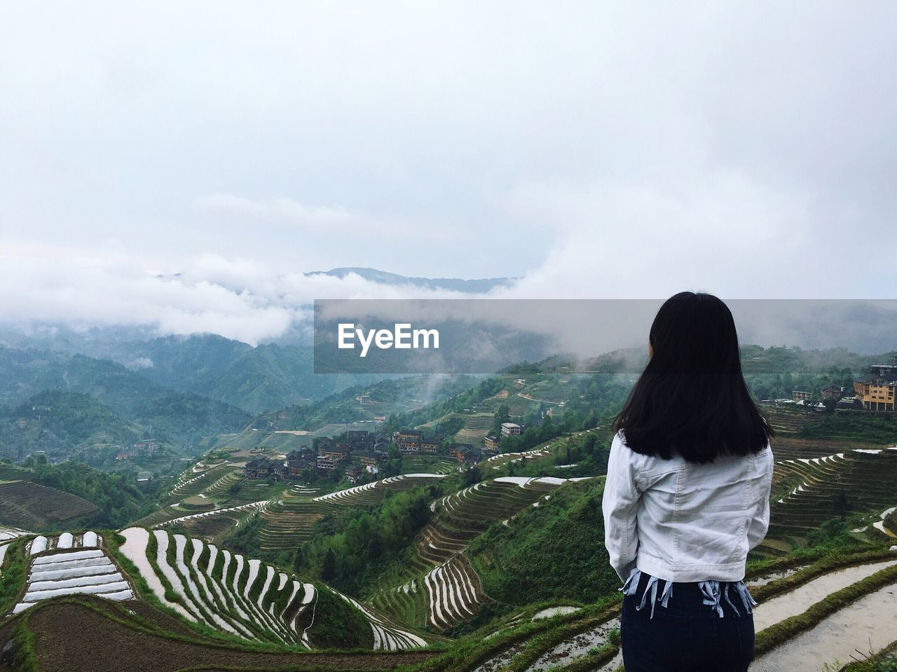 real people, rear view, one person, sky, casual clothing, mountain, nature, leisure activity, women, outdoors, lifestyles, landscape, beauty in nature, day, scenics, standing, young women, young adult, people