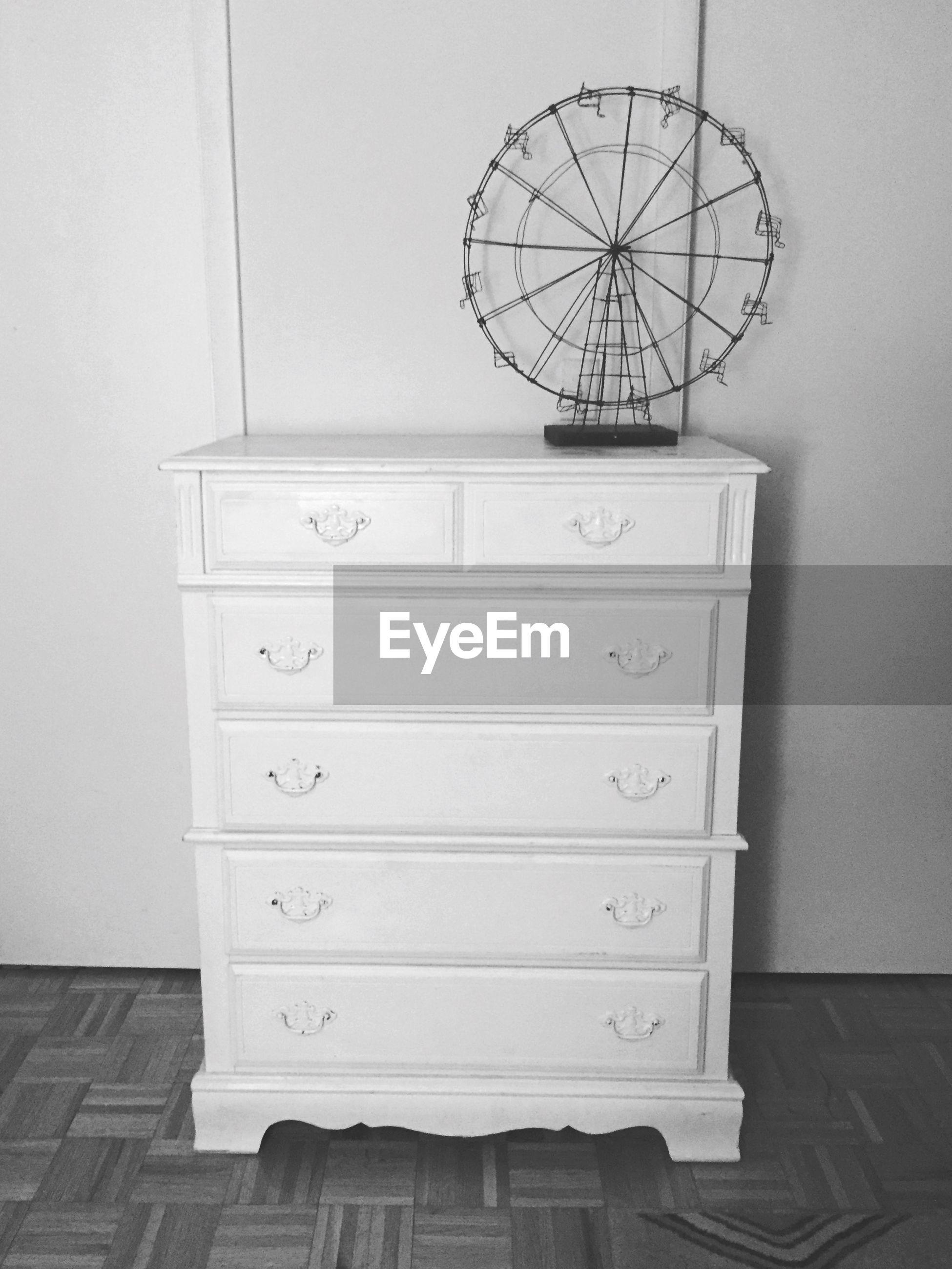Antique ferris wheel on drawer
