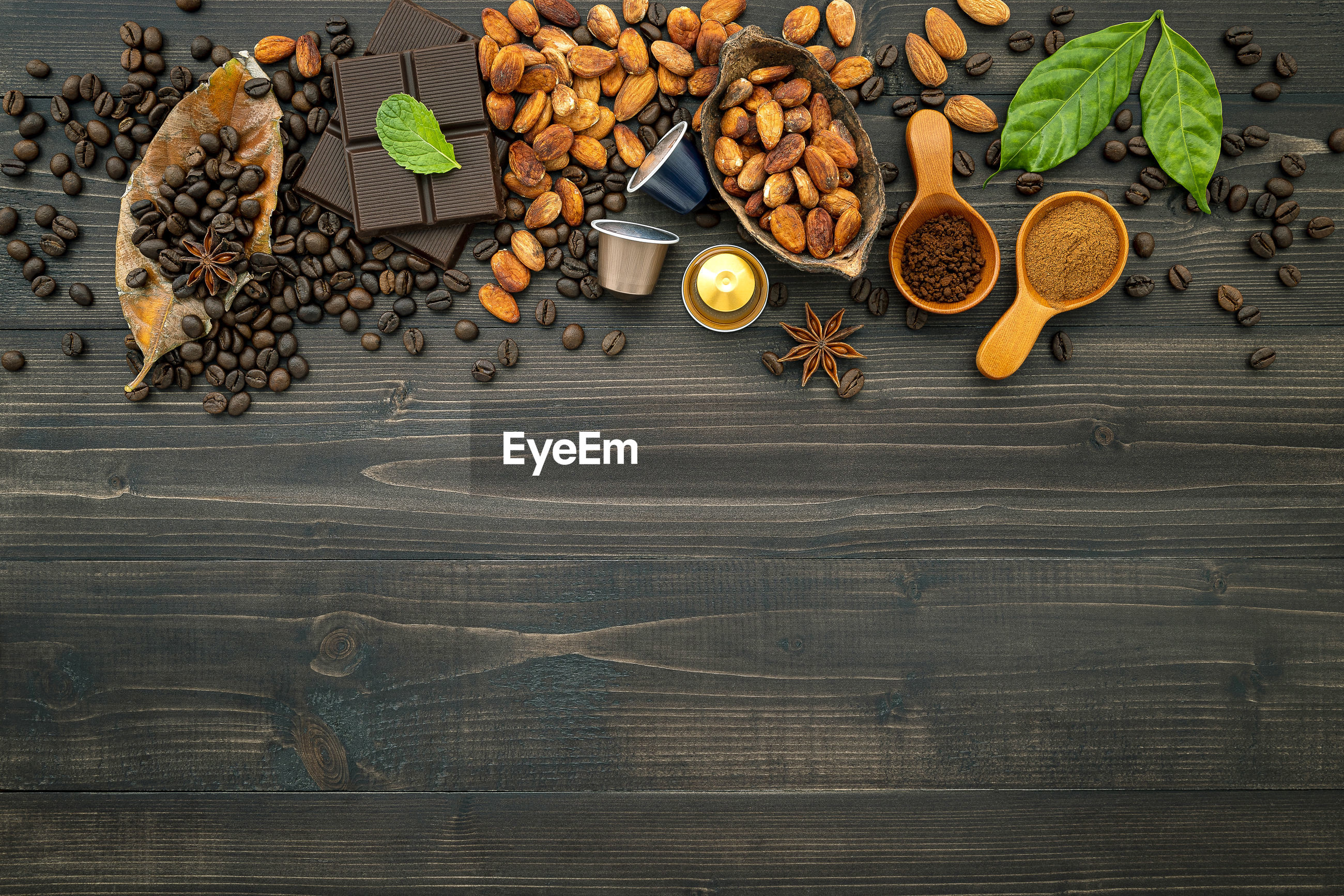 HIGH ANGLE VIEW OF COFFEE BEANS ON TABLE IN CAFE