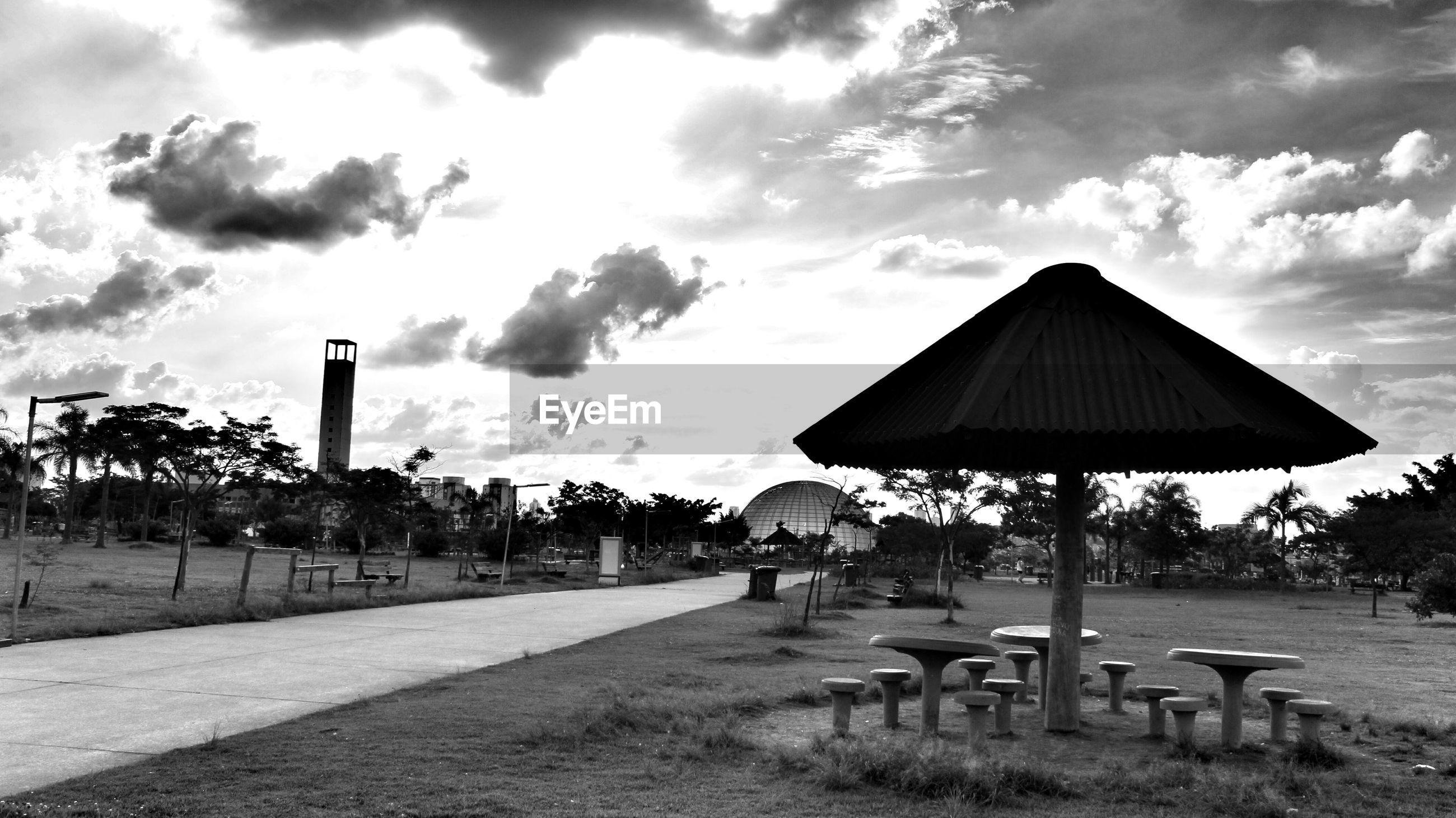 cloud - sky, sky, nature, no people, day, tree, land, plant, outdoors, architecture, seat, built structure, chair, absence, beauty in nature, field, sunlight, overcast, tranquil scene