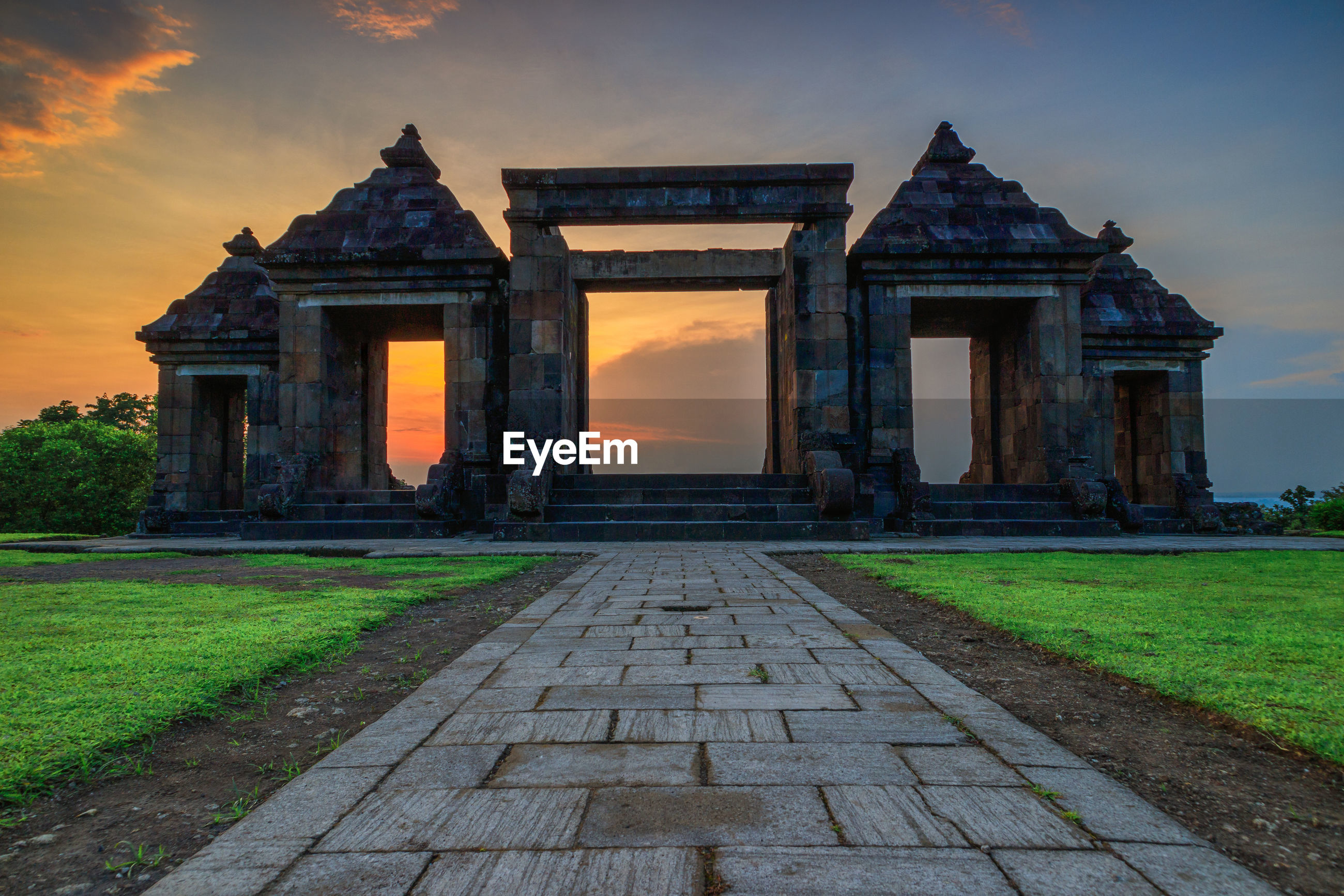 The main gate of ratu boko temple against sky during sunset