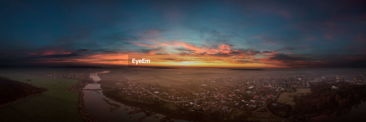 sunset, sky, cloud - sky, scenics, no people, outdoors, nature, cityscape, city, beauty in nature, tranquility, aerial view, building exterior, architecture, day
