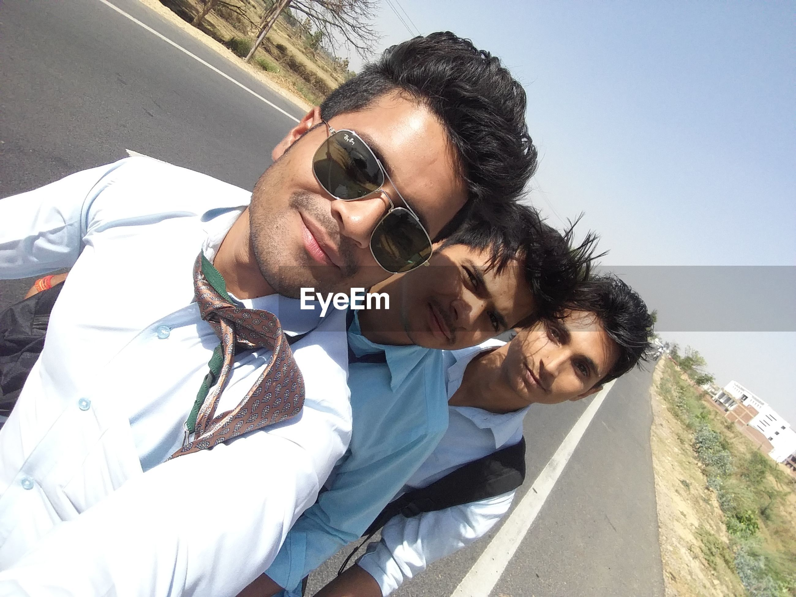 sunglasses, young men, young adult, real people, togetherness, two people, lifestyles, young women, leisure activity, sunlight, day, happiness, clear sky, bonding, men, smiling, sky, outdoors, close-up, portrait, adults only, beach, cheerful, people, adult