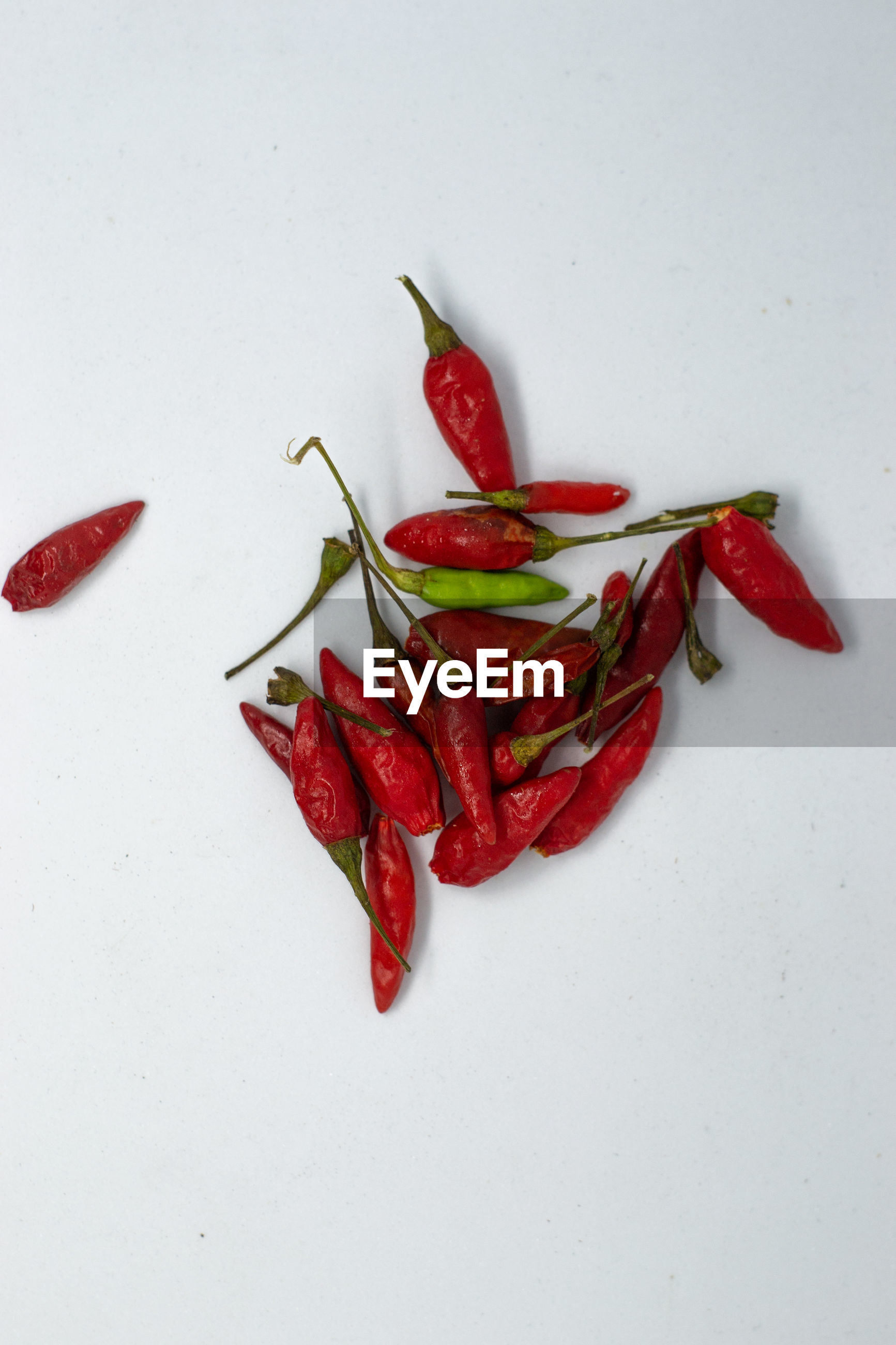 HIGH ANGLE VIEW OF CHILI PEPPERS ON WHITE BACKGROUND