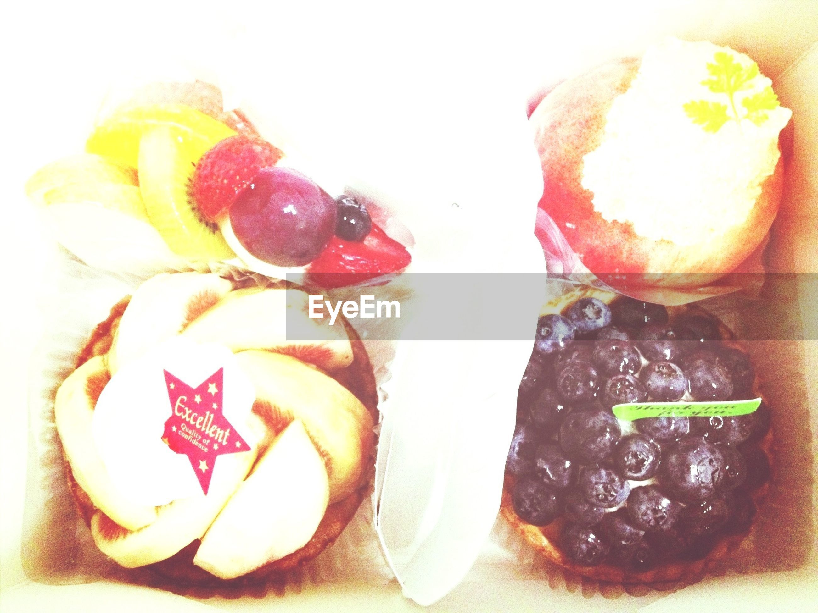 food and drink, food, indoors, freshness, sweet food, still life, ready-to-eat, dessert, indulgence, close-up, unhealthy eating, fruit, plate, temptation, cake, table, slice, chocolate, high angle view
