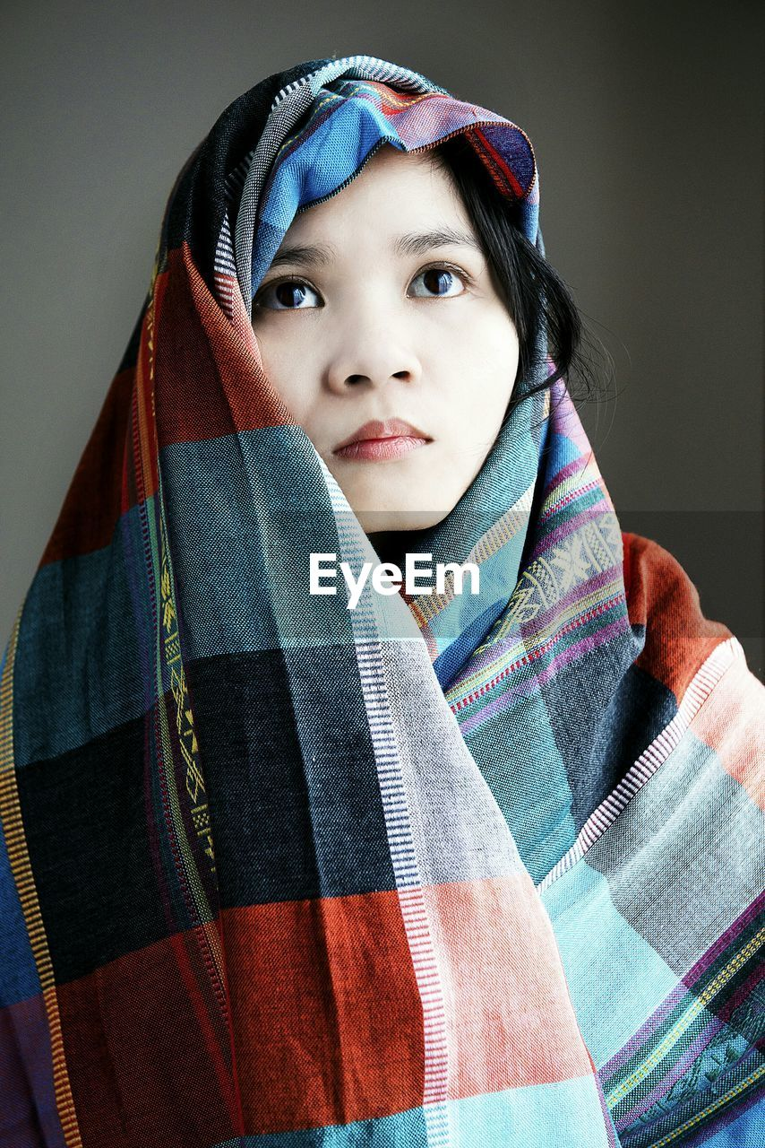 one person, portrait, clothing, indoors, headshot, front view, lifestyles, child, real people, leisure activity, childhood, looking at camera, casual clothing, scarf, close-up, looking, warm clothing, hood - clothing, human face, contemplation
