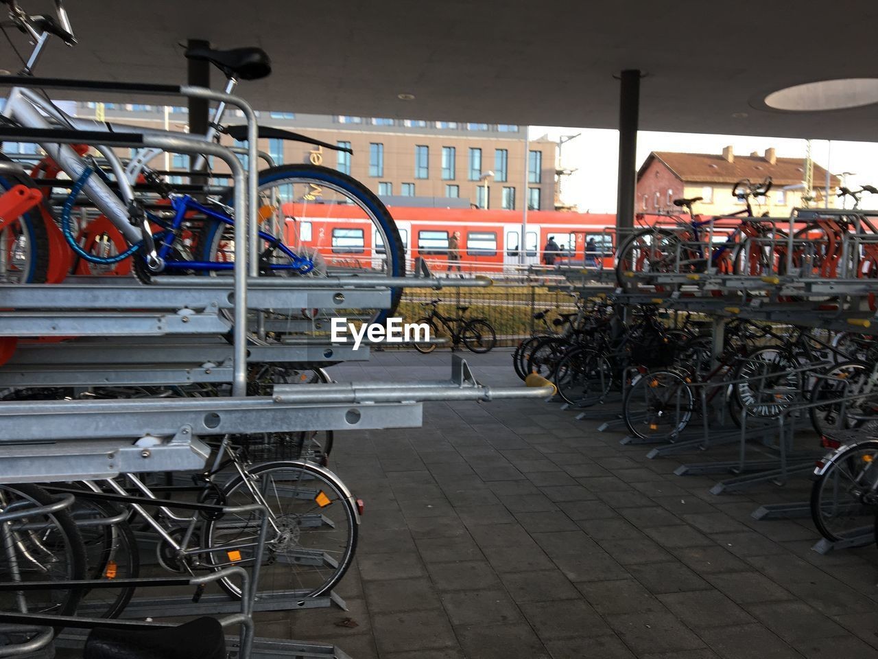 bicycle, transportation, mode of transport, land vehicle, stationary, bicycle rack, no people, large group of objects, day, outdoors