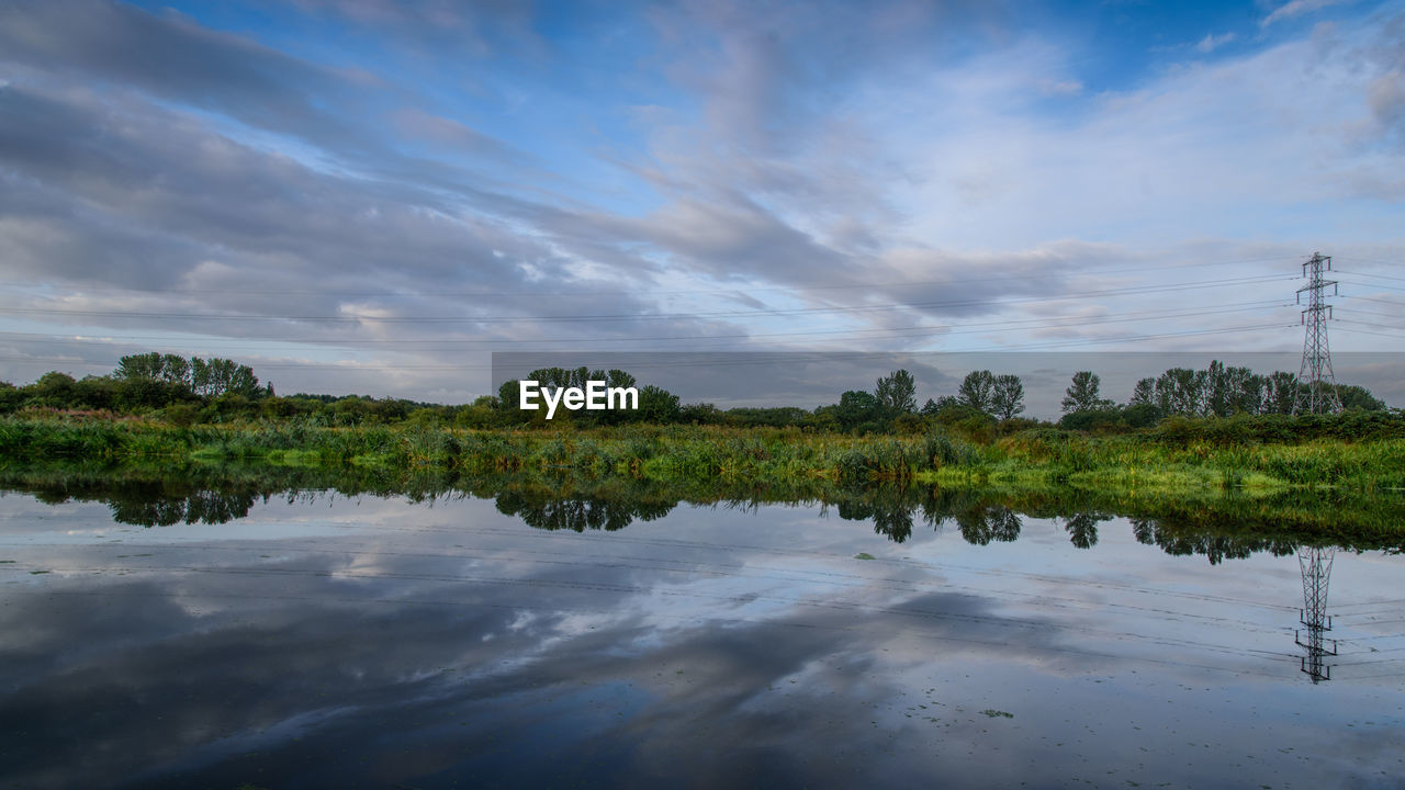 cloud - sky, reflection, water, sky, scenics - nature, tranquil scene, tranquility, beauty in nature, lake, tree, plant, nature, no people, waterfront, non-urban scene, idyllic, day, growth, green color, outdoors