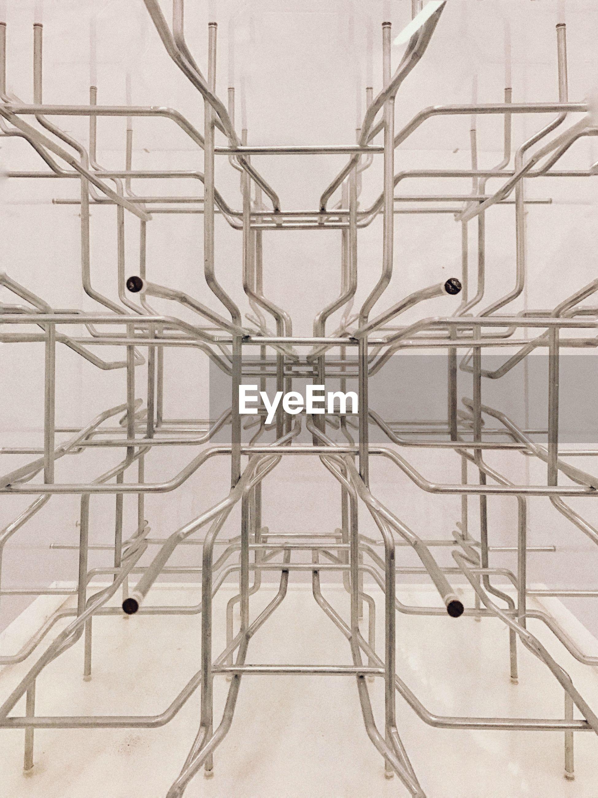 DIRECTLY BELOW SHOT OF MODERN GLASS WALL