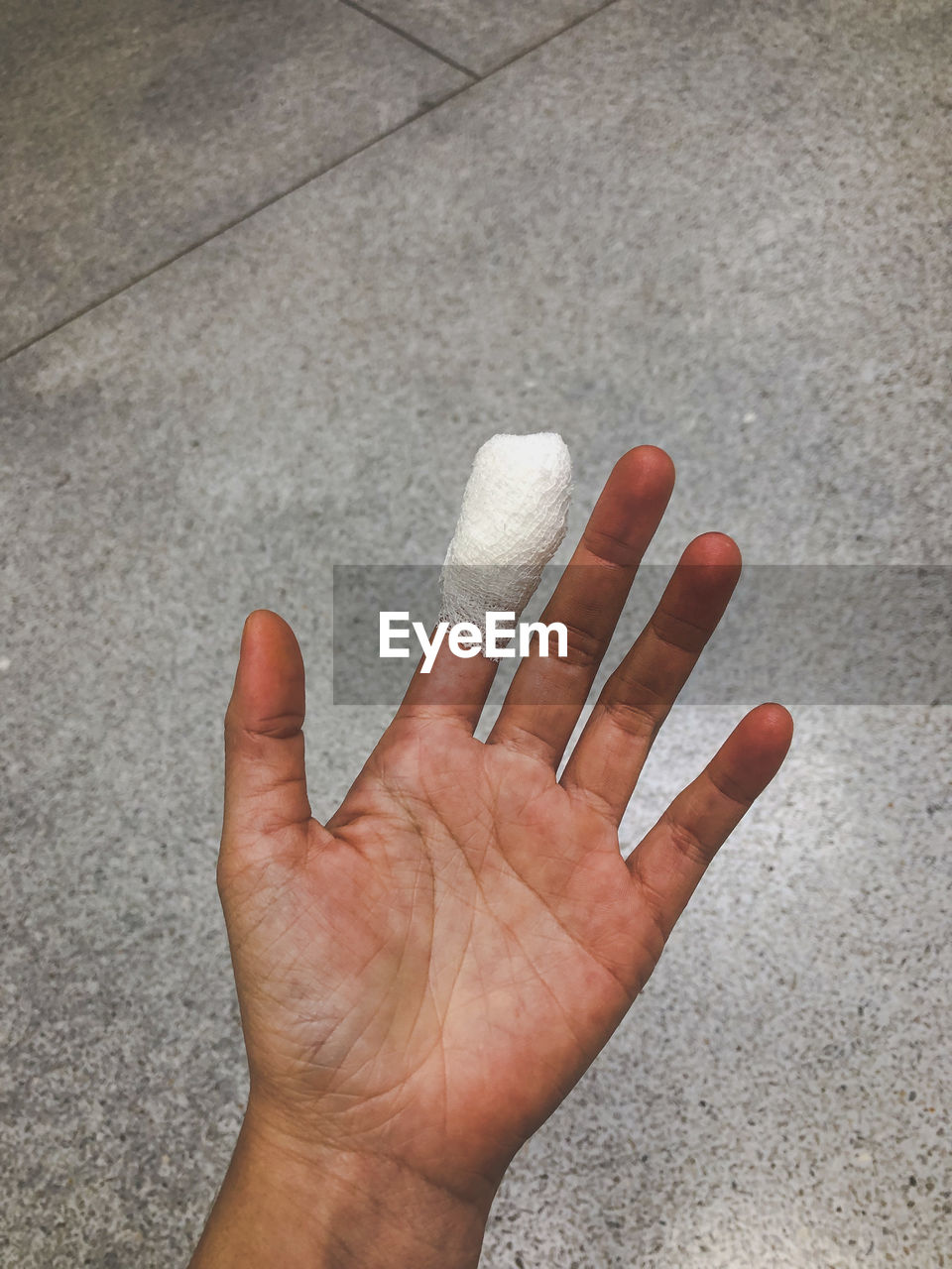 Close-up of hand with bandage on finger