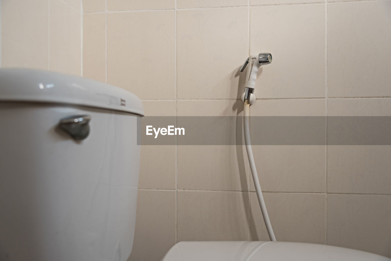 Close-up of flush tank over toilet seat