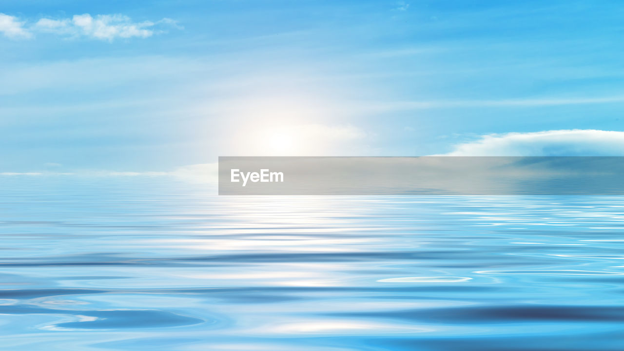 sky, beauty in nature, water, scenics - nature, cloud - sky, tranquility, nature, sunlight, tranquil scene, no people, reflection, sea, blue, day, waterfront, outdoors, idyllic, horizon, horizon over water, lens flare, purity