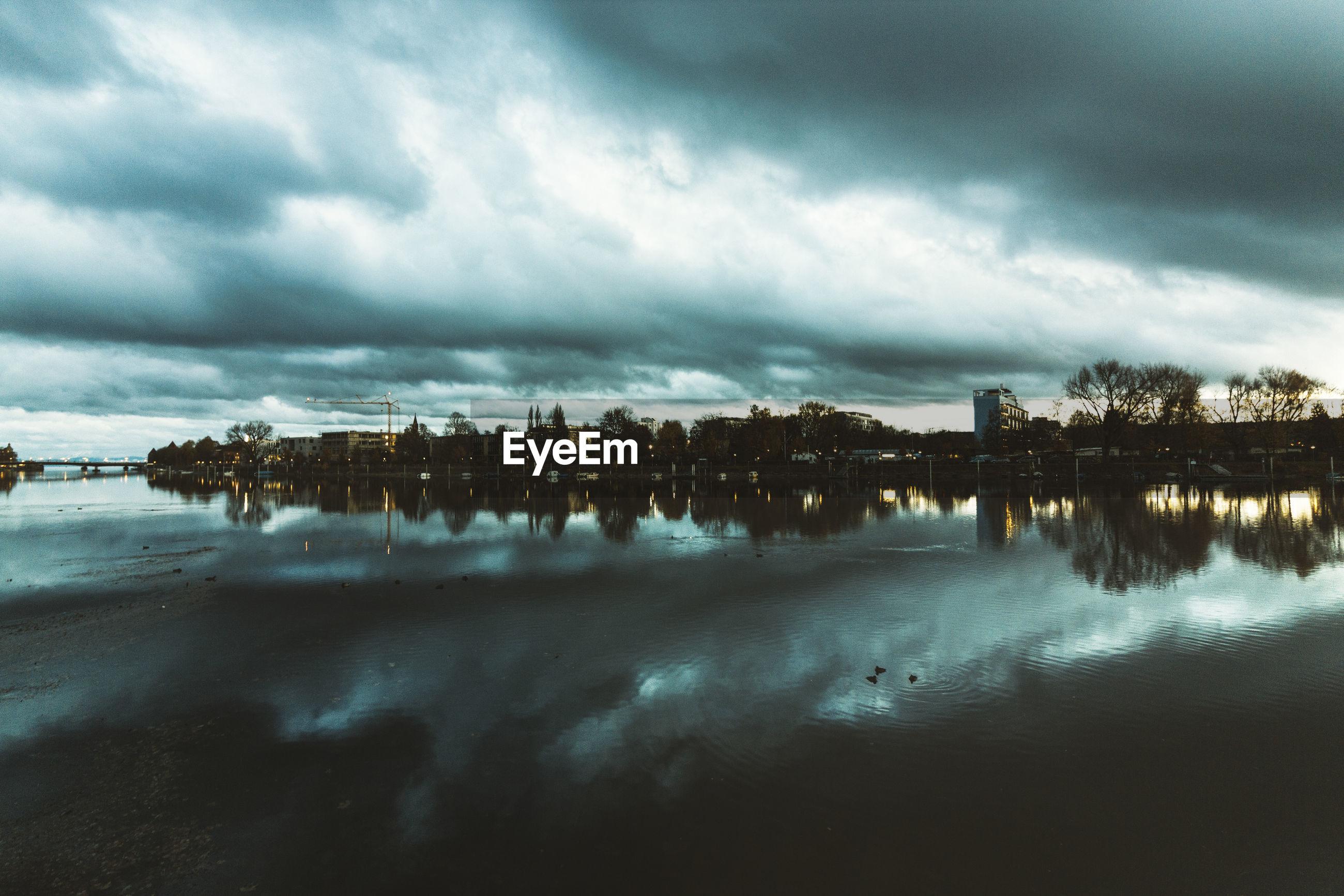 Cloudy sky reflecting on calm lake