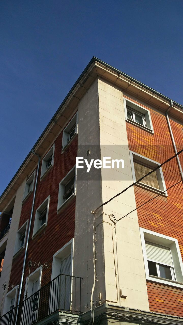window, building exterior, architecture, built structure, low angle view, no people, day, apartment, clear sky, sky, outdoors