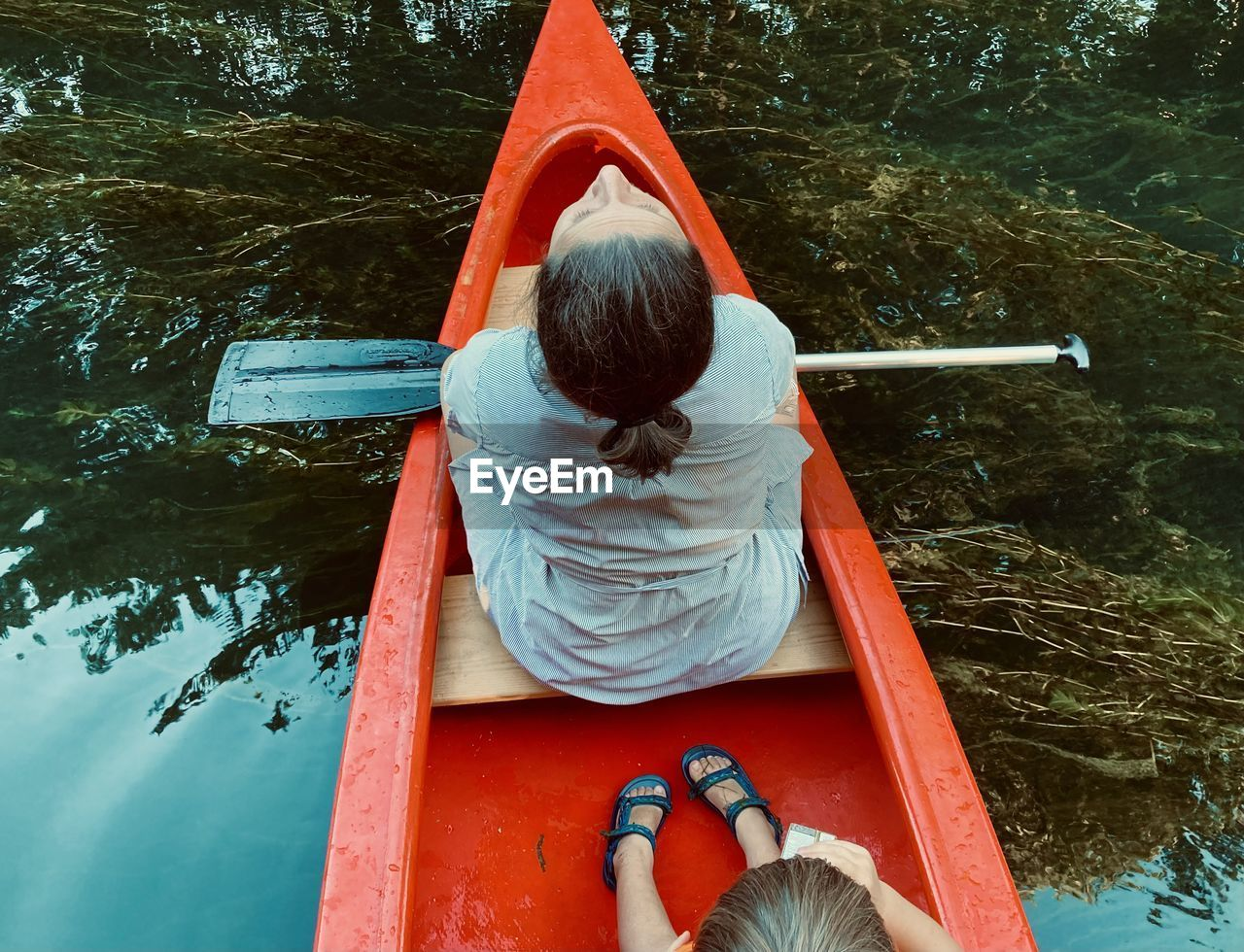 Rear view of man sitting on boat at playground