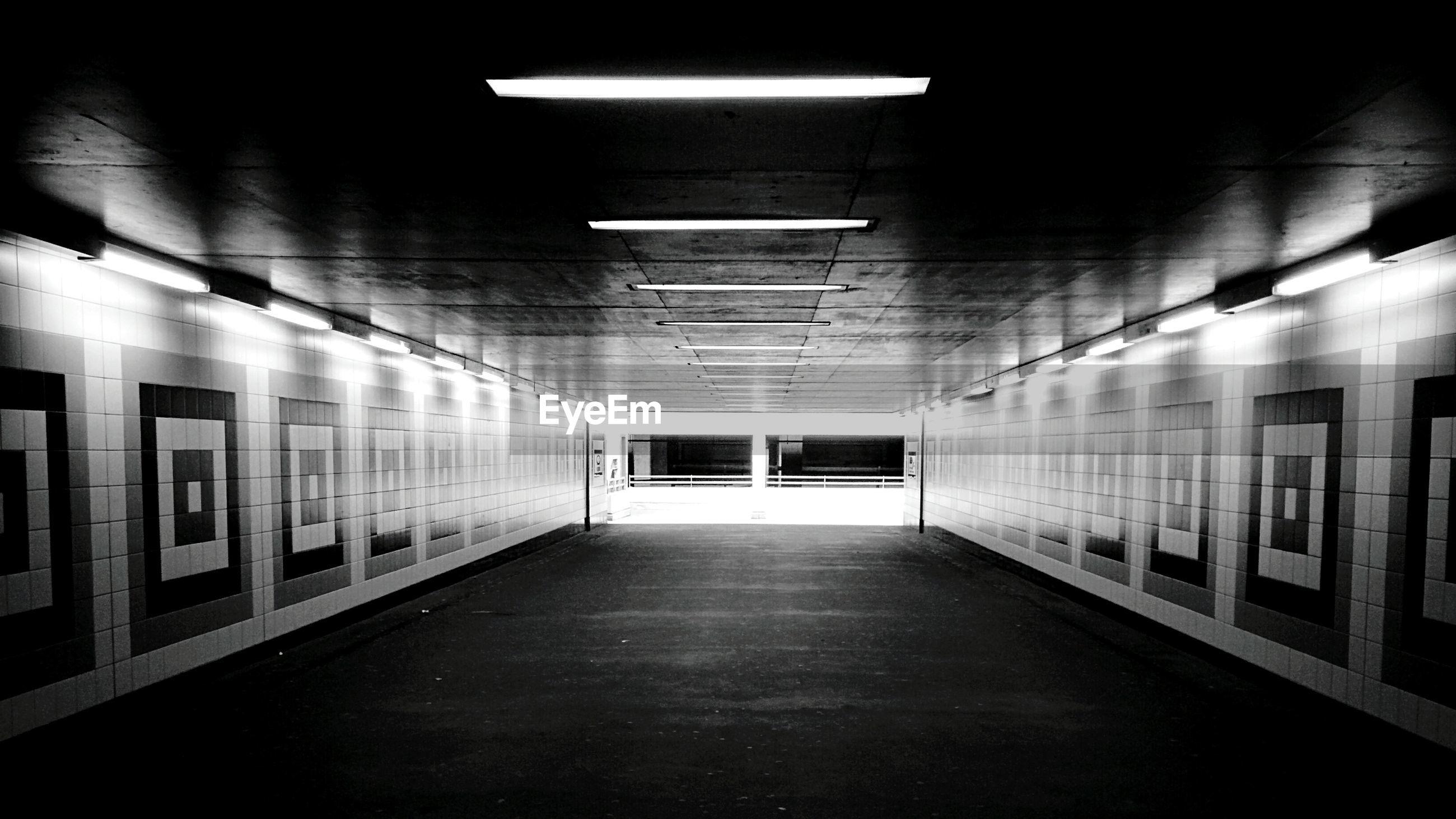 Illuminated empty subway tunnel