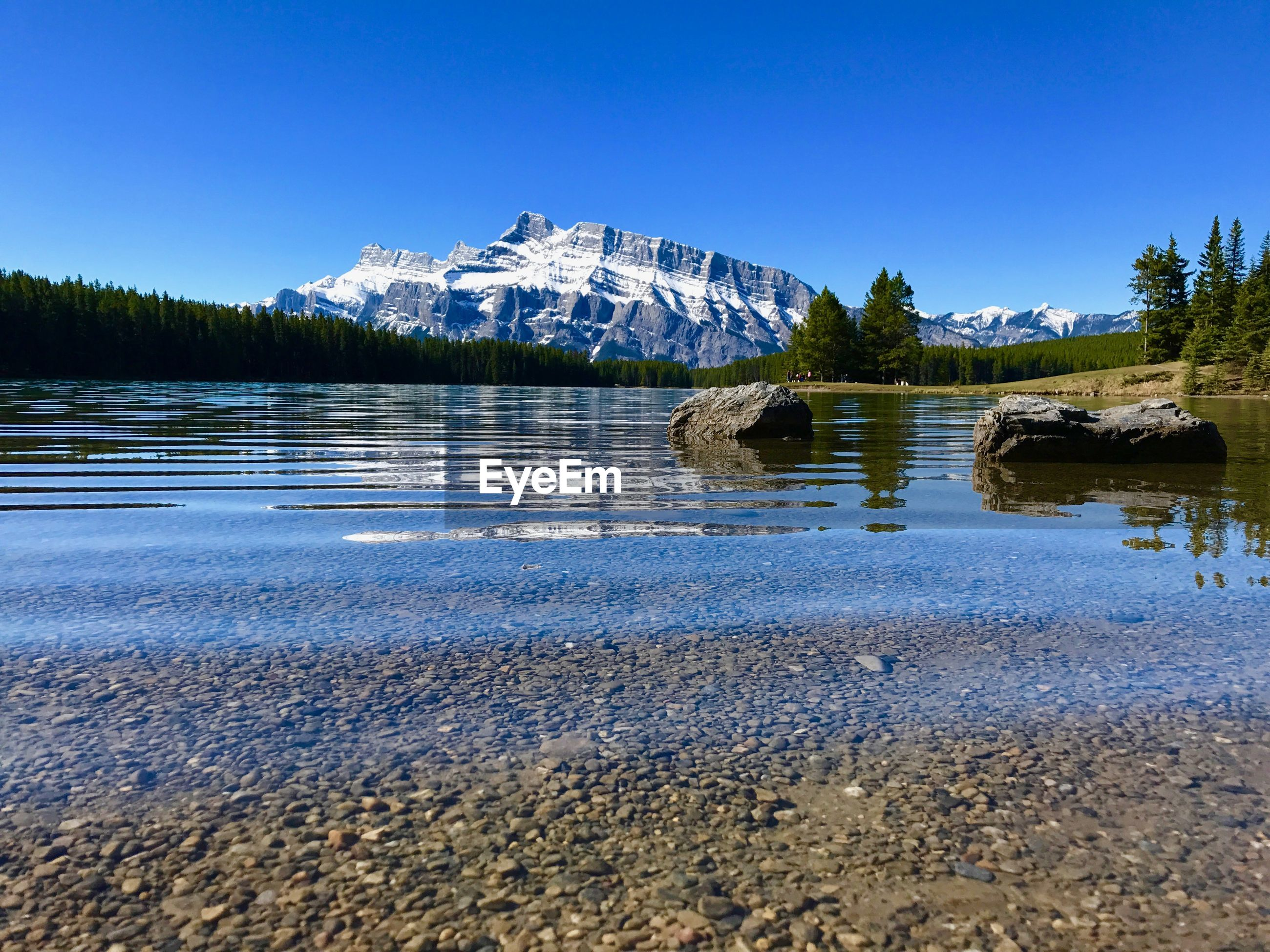 Scenic view of vermillion lakes with mt rundle in background during winter