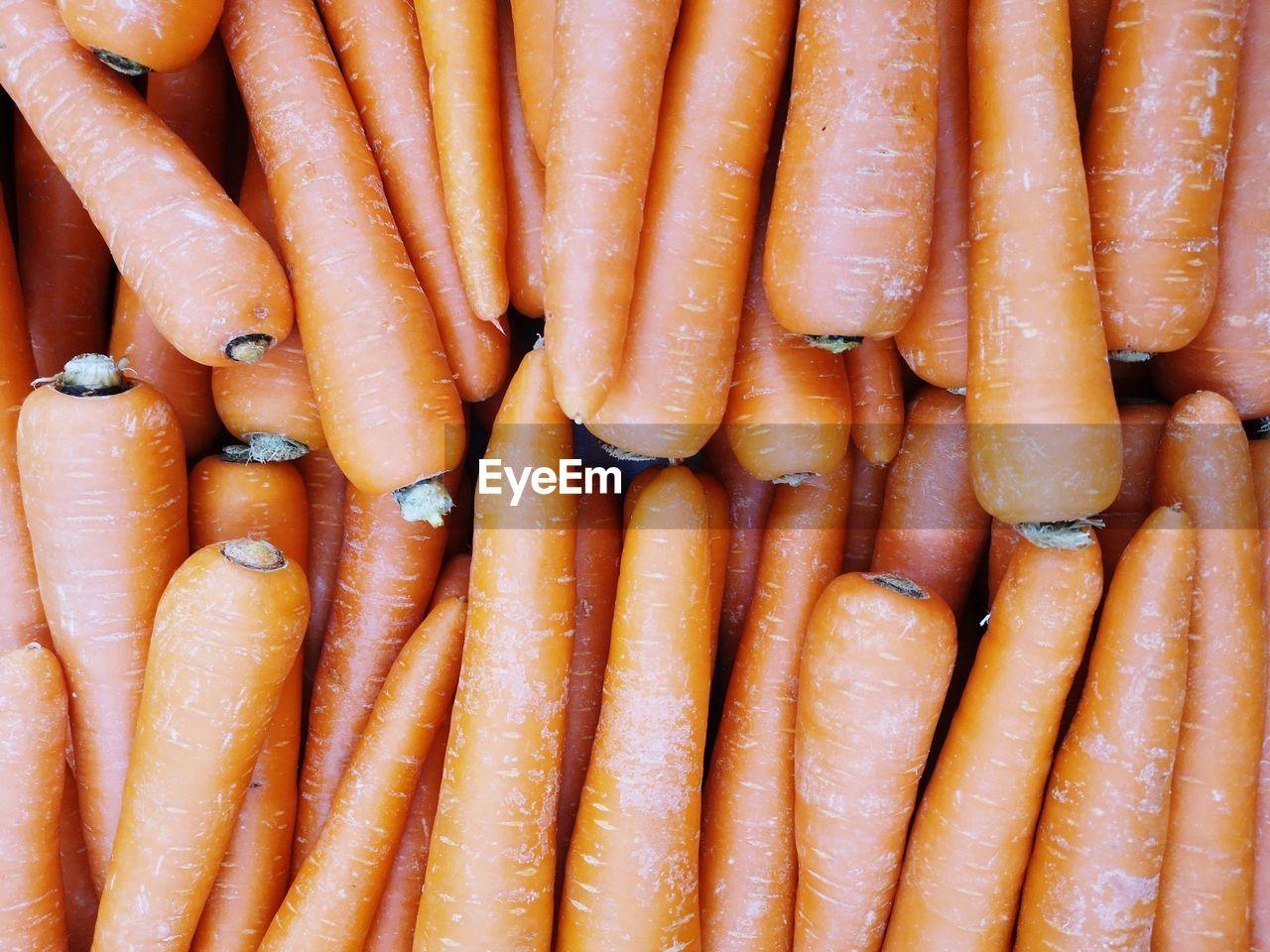 Full frame shot of carrots for sale at market