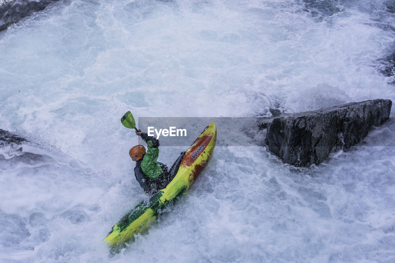 sport, motion, water, adventure, day, nautical vessel, nature, high angle view, beauty in nature, speed, waterfront, aquatic sport, lifestyles, outdoors, winter, leisure activity, cold temperature, transportation, flowing water, inflatable, power in nature