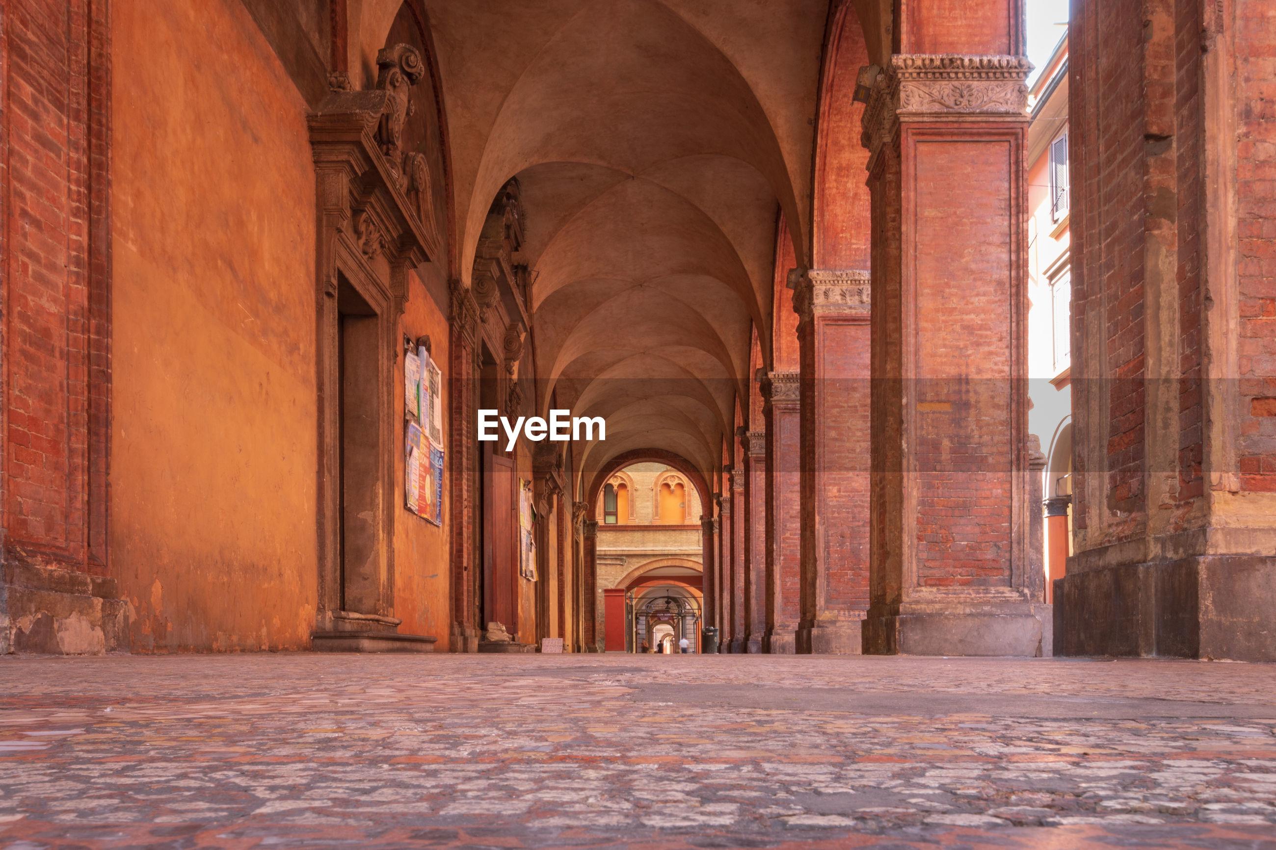 Famous arcades at via maggiore next to church santi bartolomeo e gaetano