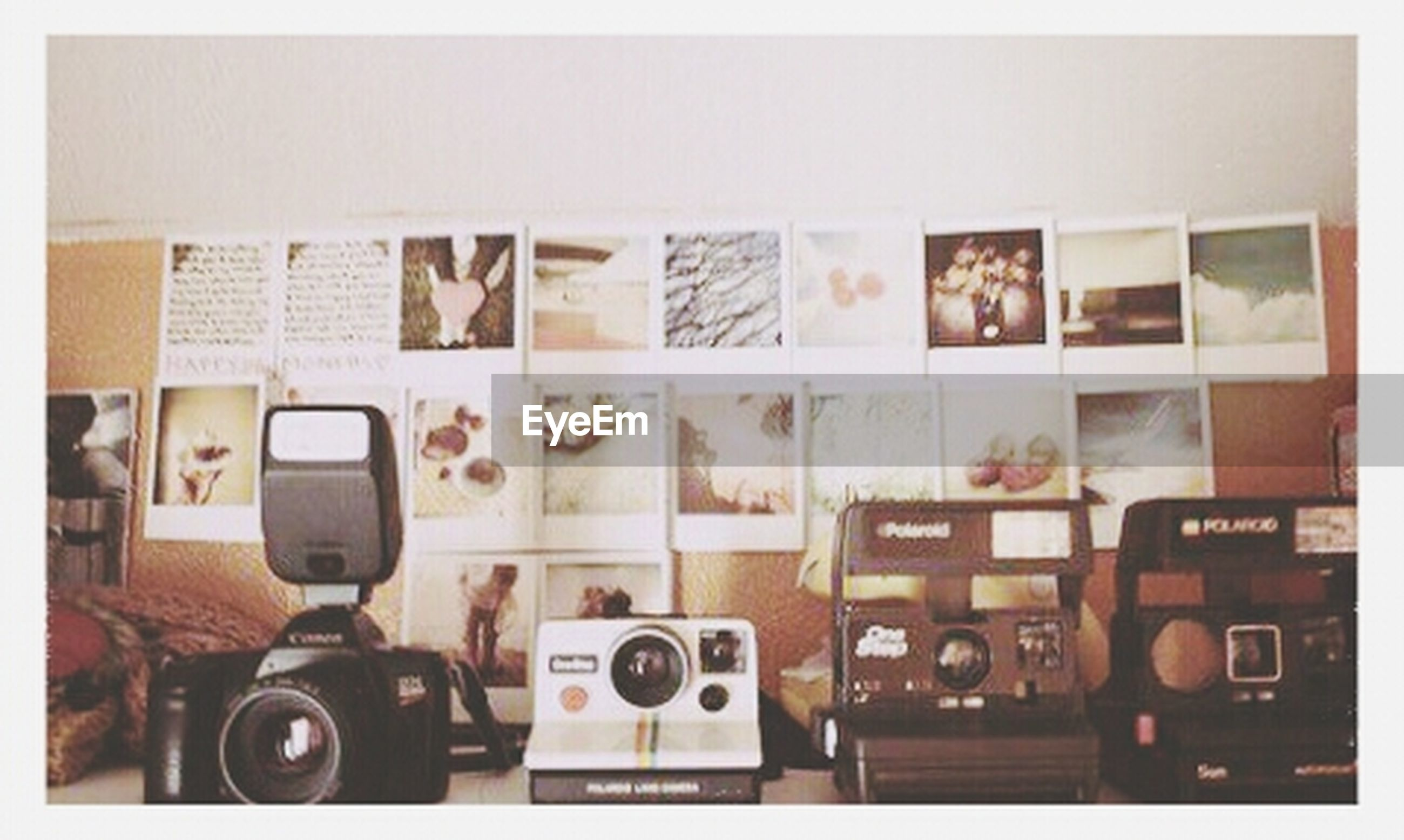 transfer print, indoors, auto post production filter, in a row, large group of objects, order, variation, arrangement, still life, shelf, communication, side by side, choice, technology, abundance, table, stack, no people, text, store